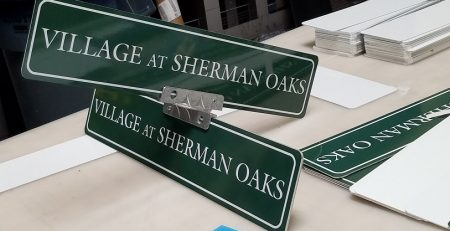 aluminum signs, full color digital signs, printed vinyl, campus signage, sign mounting, parking lot signs, faux street signs, themed signage, sherman oaks, the village