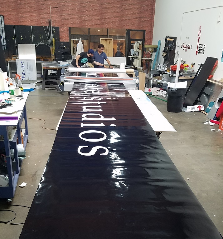 oversized light box insert, large signs, light box inserts, lexan signs, exterior signs, sign makers, entertainment signage, studio city, media sign