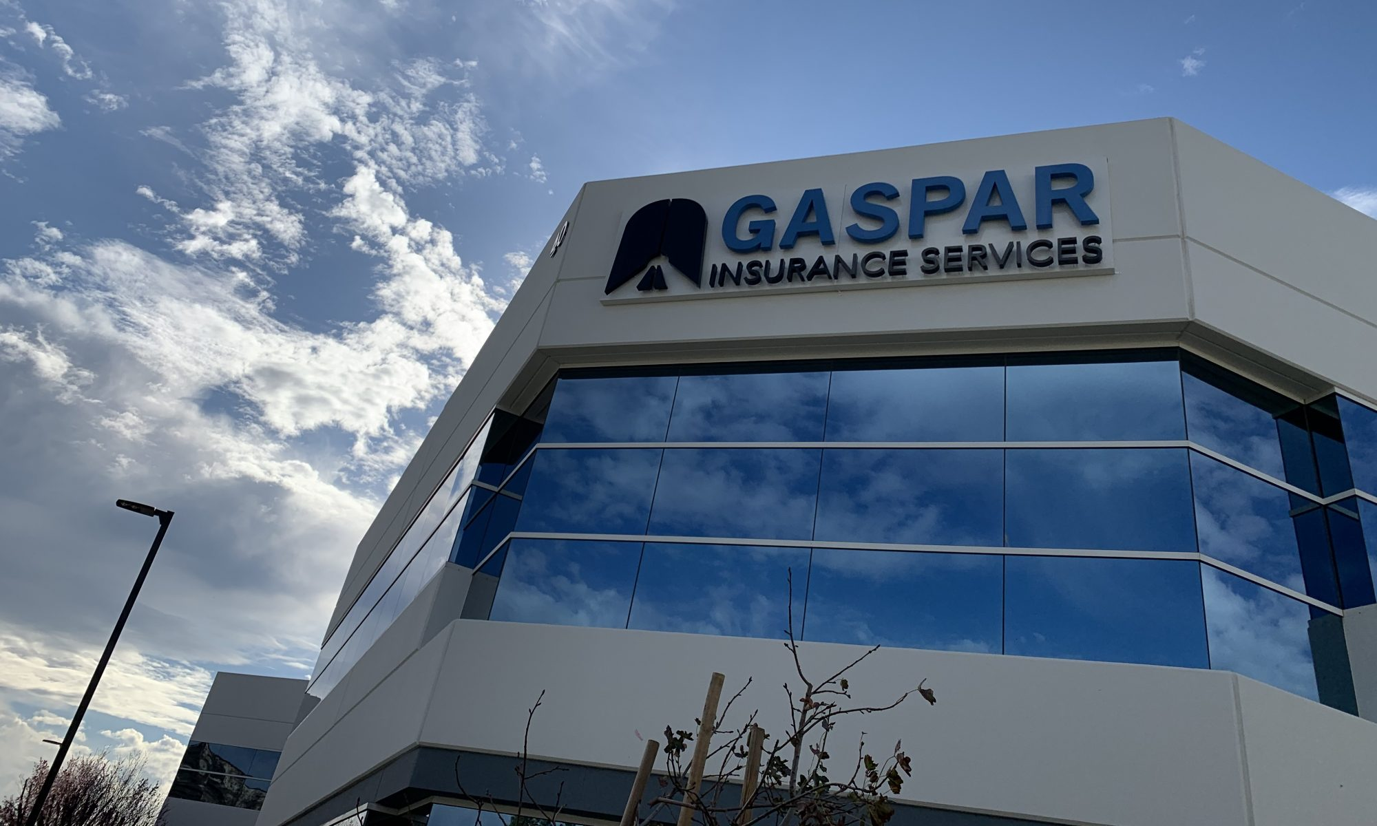 Exterior photos of reverse lit channel letters on the Gaspar Insurance office building in Simi Valley. This exterior building sign is part of the office sign package provided by Premium Sign Solutions. Sign Makers in Simi Valley.