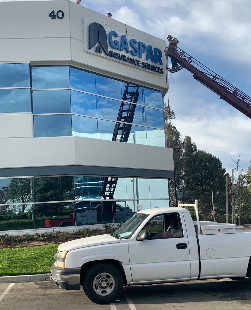 Exterior photos of reverse lit channel letters being installed by crane on the Gaspar Insurance office building in Simi Valley. This exterior building sign is part of the office sign package provided by Premium Sign Solutions. Sign Makers in Simi Valley.