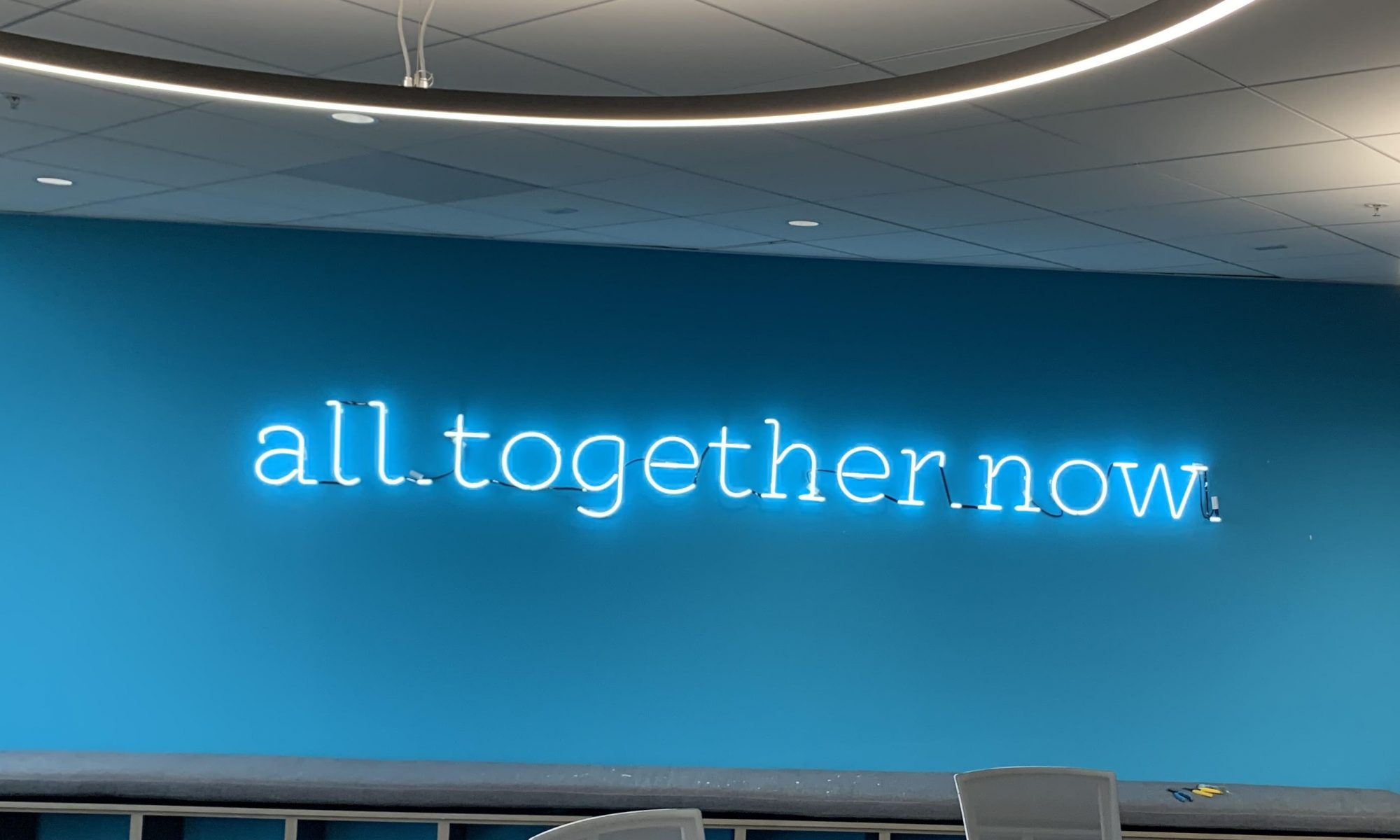 "More of the sign package we worked on for Abbyson's headquarters in Calabasas. This neon lobby sign displays the words ""all together now"" brightly."
