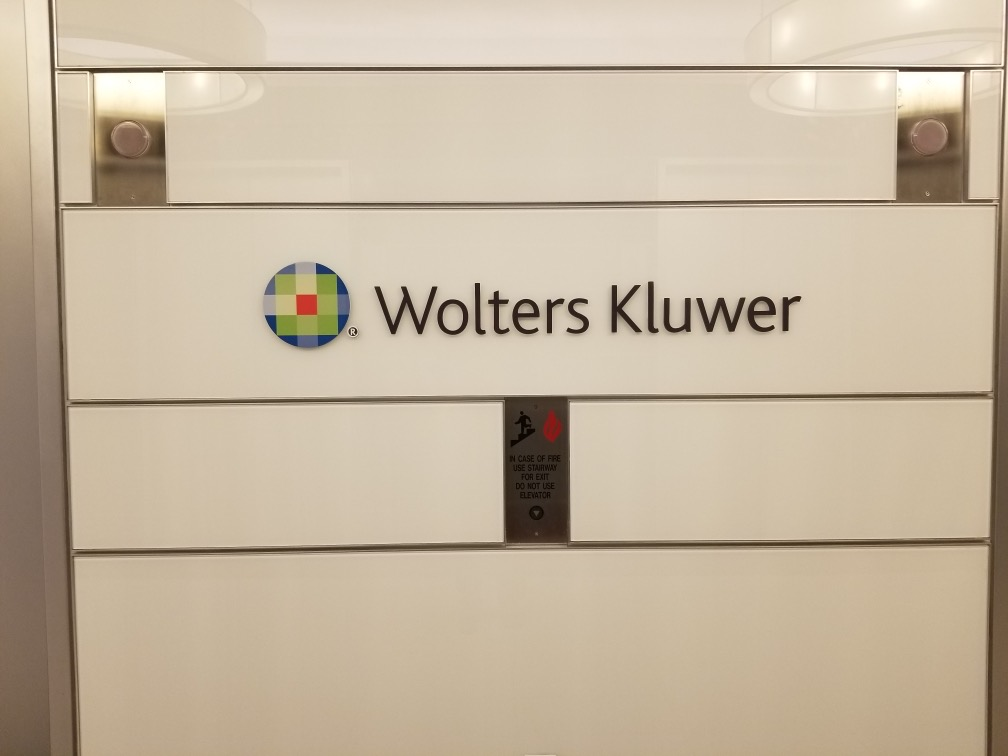 Guide people to your office with a hallway sign, like this one we made for Wolters Kluwer in Glendale that likewise compliments its lobby sign.