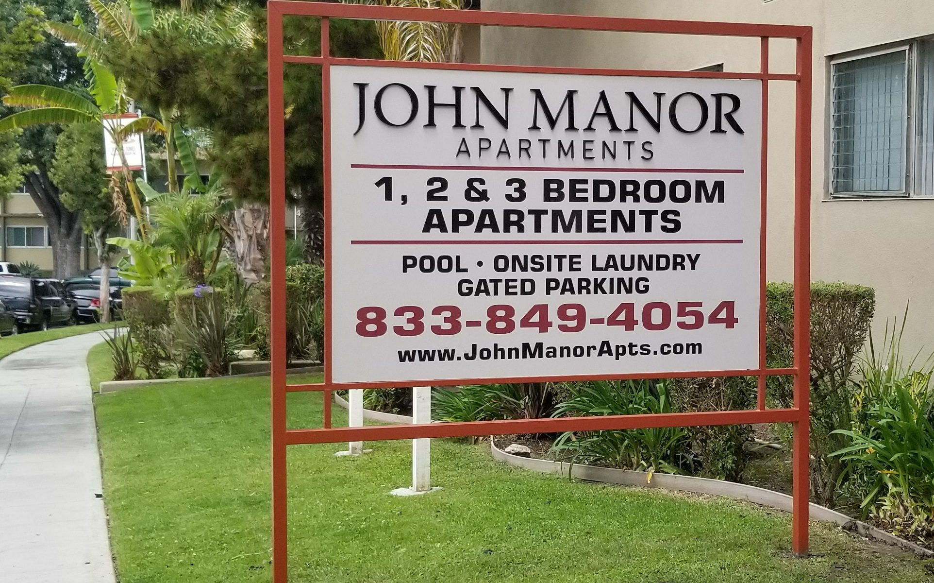 We built this post and panel monument sign for John Manor Apartments and Jones and Jones Communities in Los Angeles.