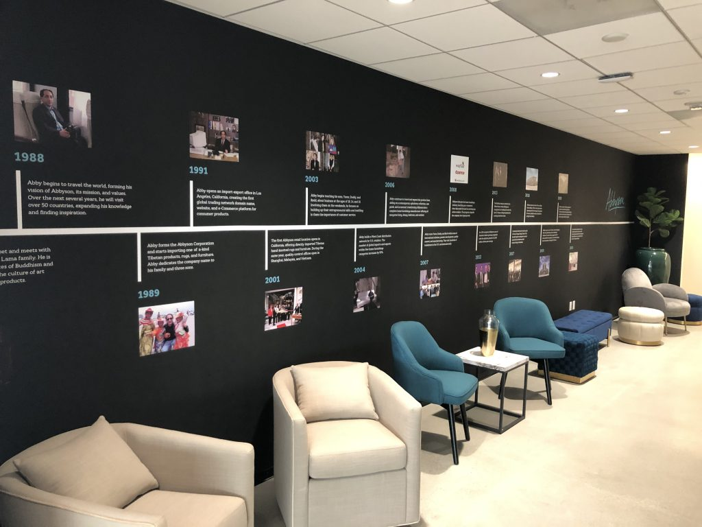 We often mention conveying brand identity through signage. Timeline wall graphics are a great way to do this, like with Abbyson's office in Woodland Hills.