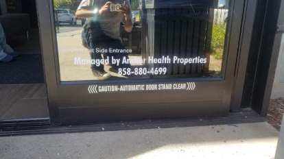 Property managers often need let visitors know who manages the property. Here, we created cut vinyl entrance window graphics for Anchor Health in Westlake.