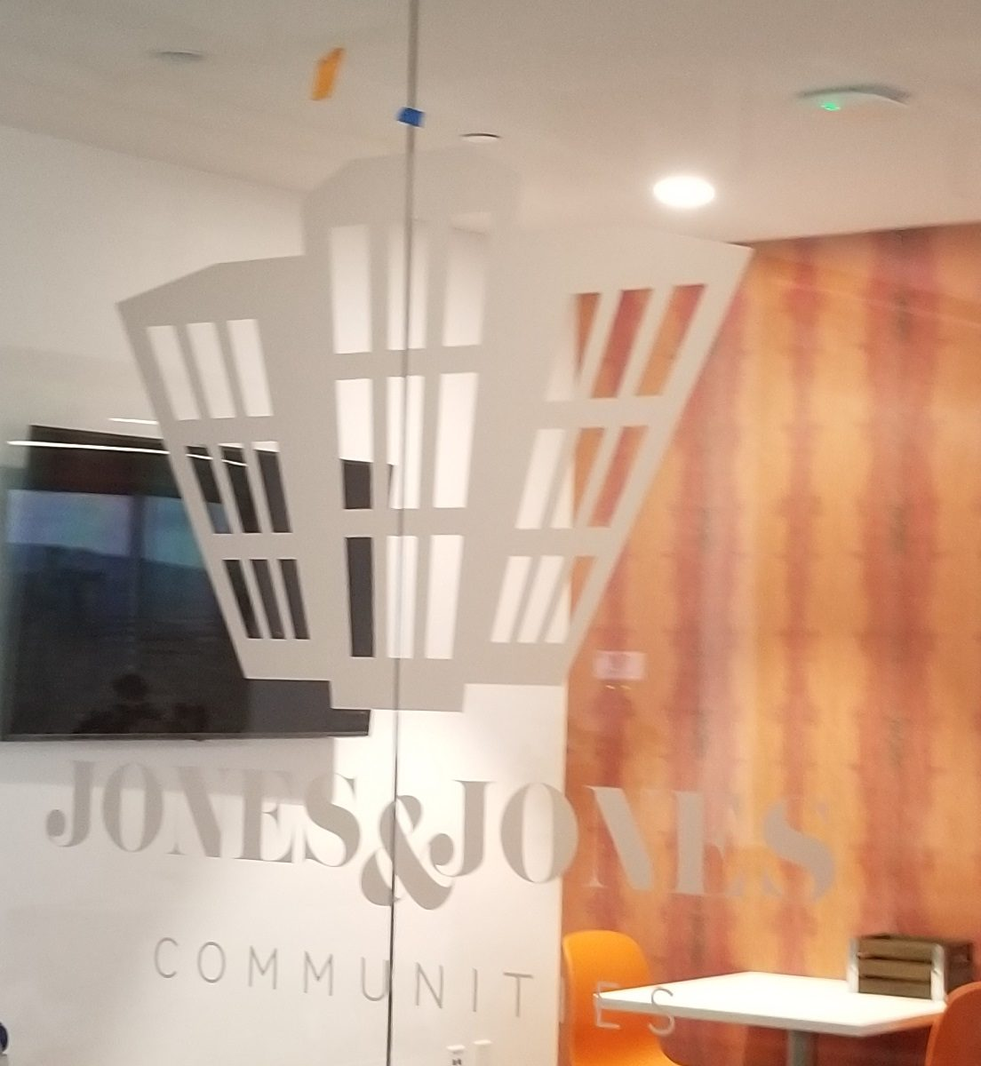 In the Jones and Jones office reception area, we added etched glass window graphics.