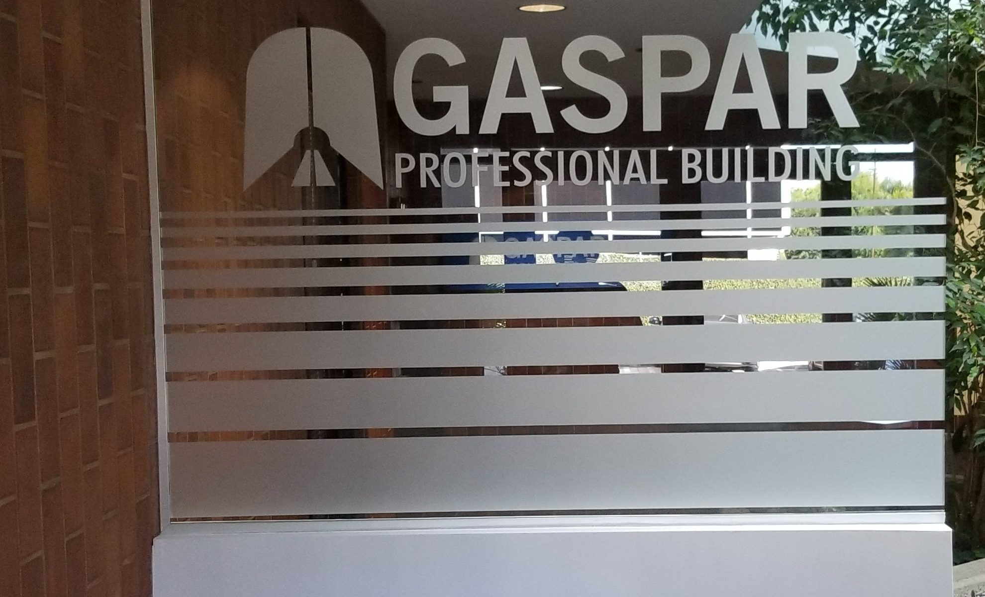 Make your lobby desk presentable with signage. Like this etched vinyl office window graphics for Gaspar Insurance in Woodland Hills.