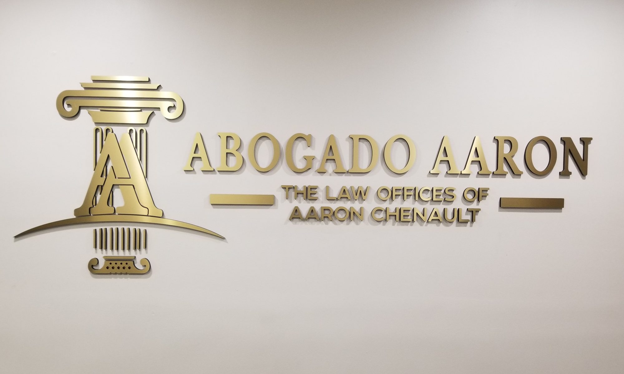 The impressive law office lobby sign we made and installed for Abogado Aaron's Los Angeles branch, conveying the caliber of legal services they provide.