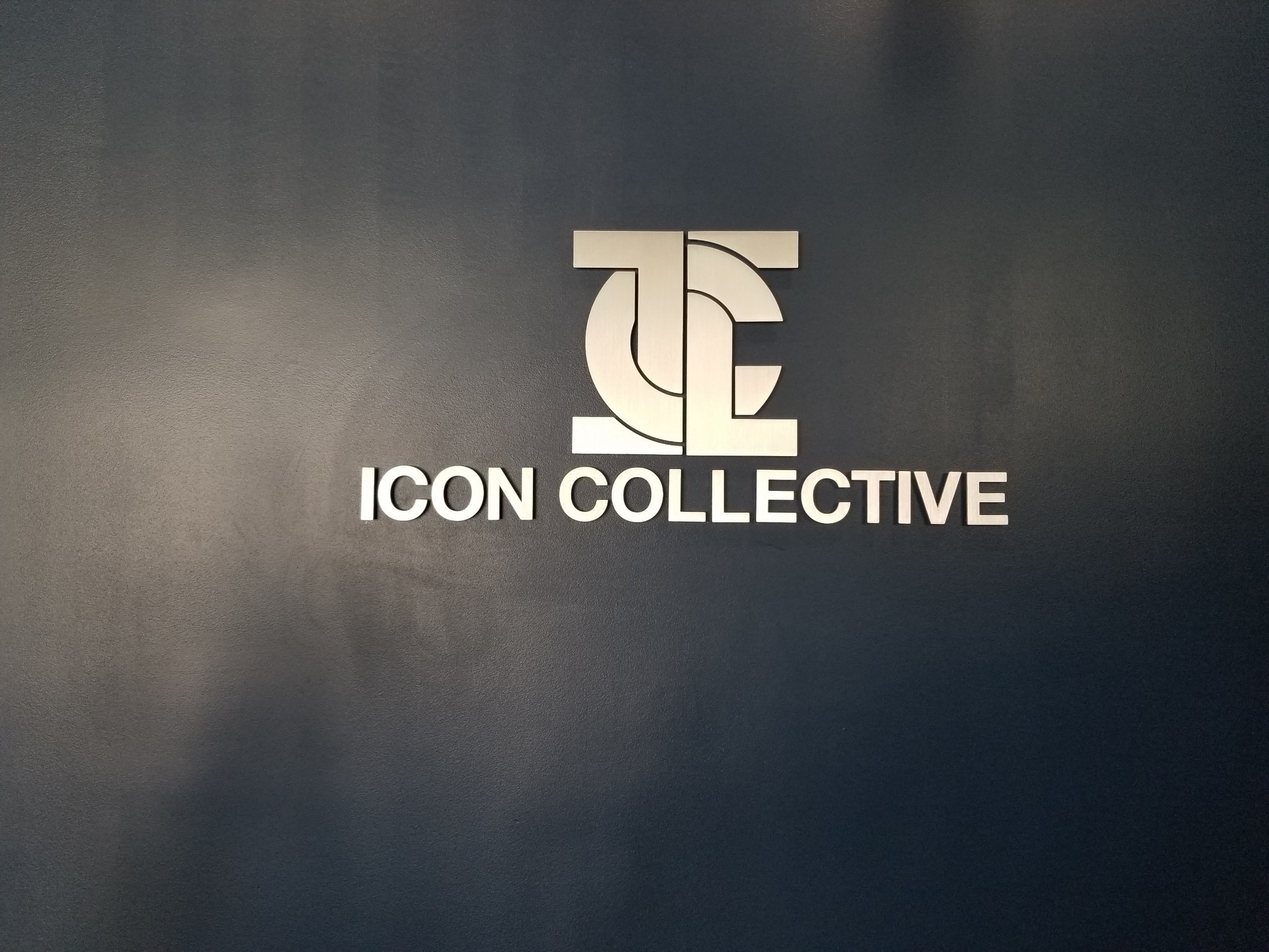 This is the metal lobby sign we installed for Icon Collective, part of a large outdoor and indoor business sign package for the school in Burbank.