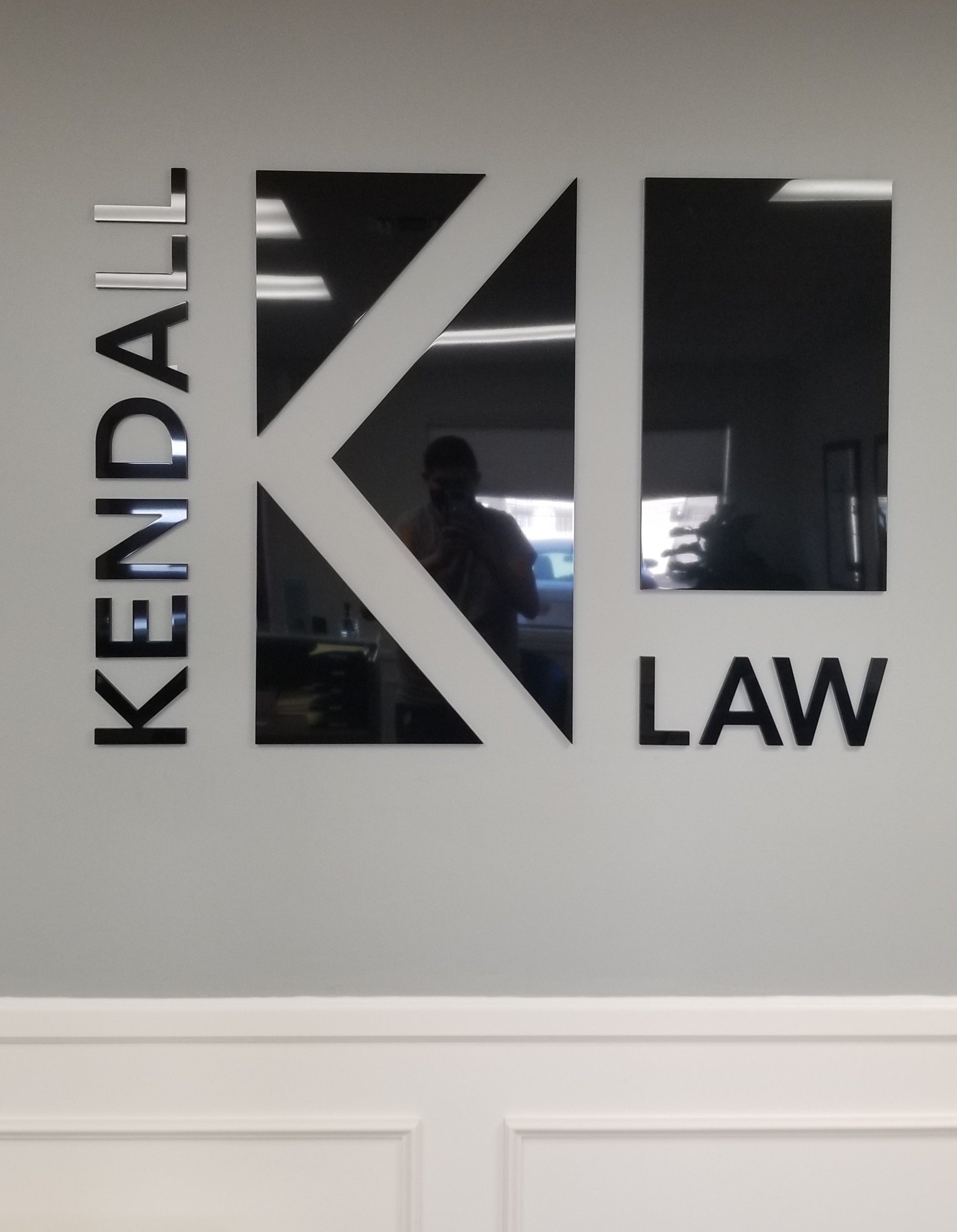 This is the law office lobby sign for Kendall Law. With this, the Torrance firm has a prominent centerpiece in their reception area.