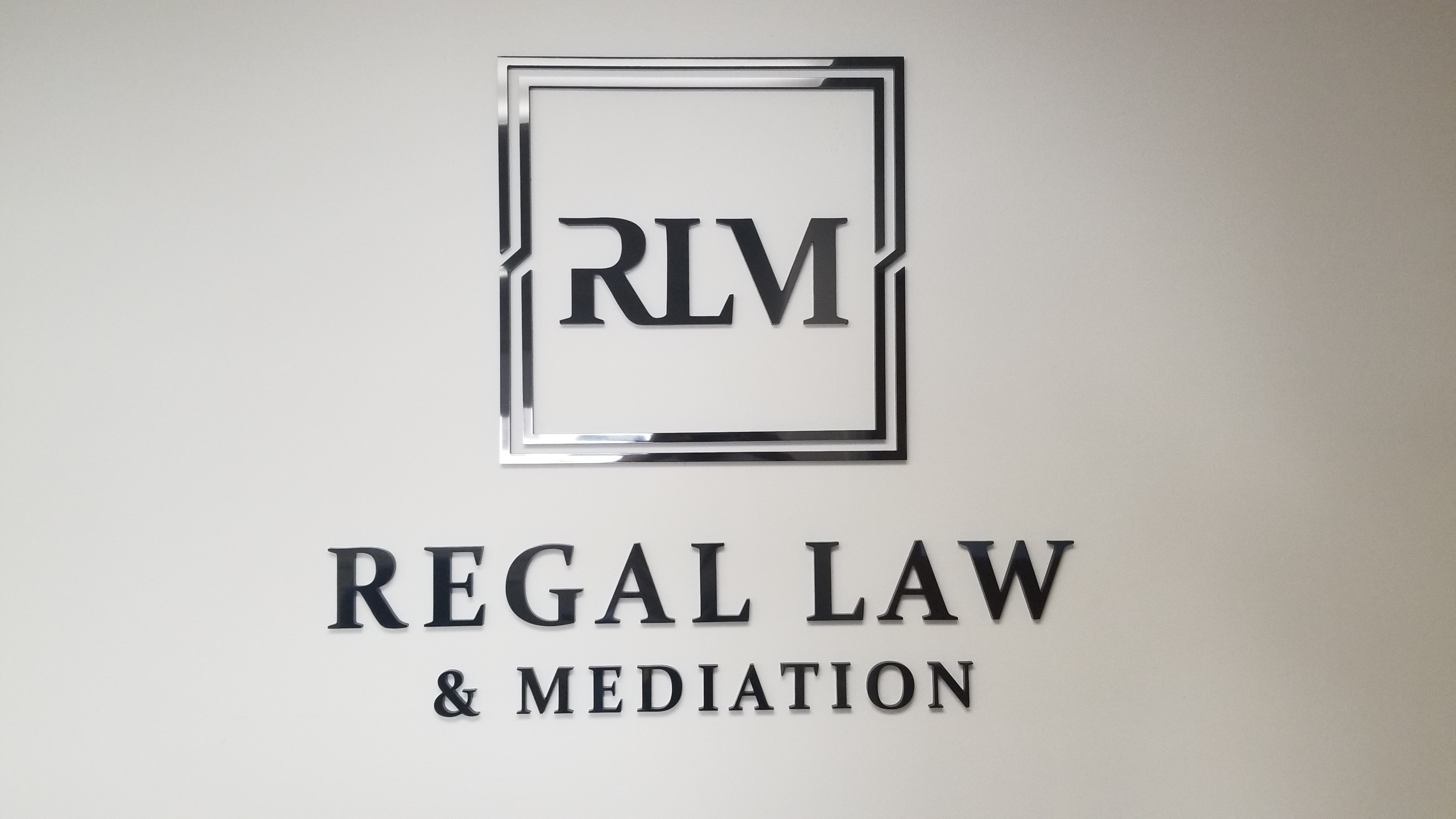 This time the focus is on the laser-cut acrylic office lobby sign for Regal Law. Now the Torrance legal firm has a stunning centerpiece.