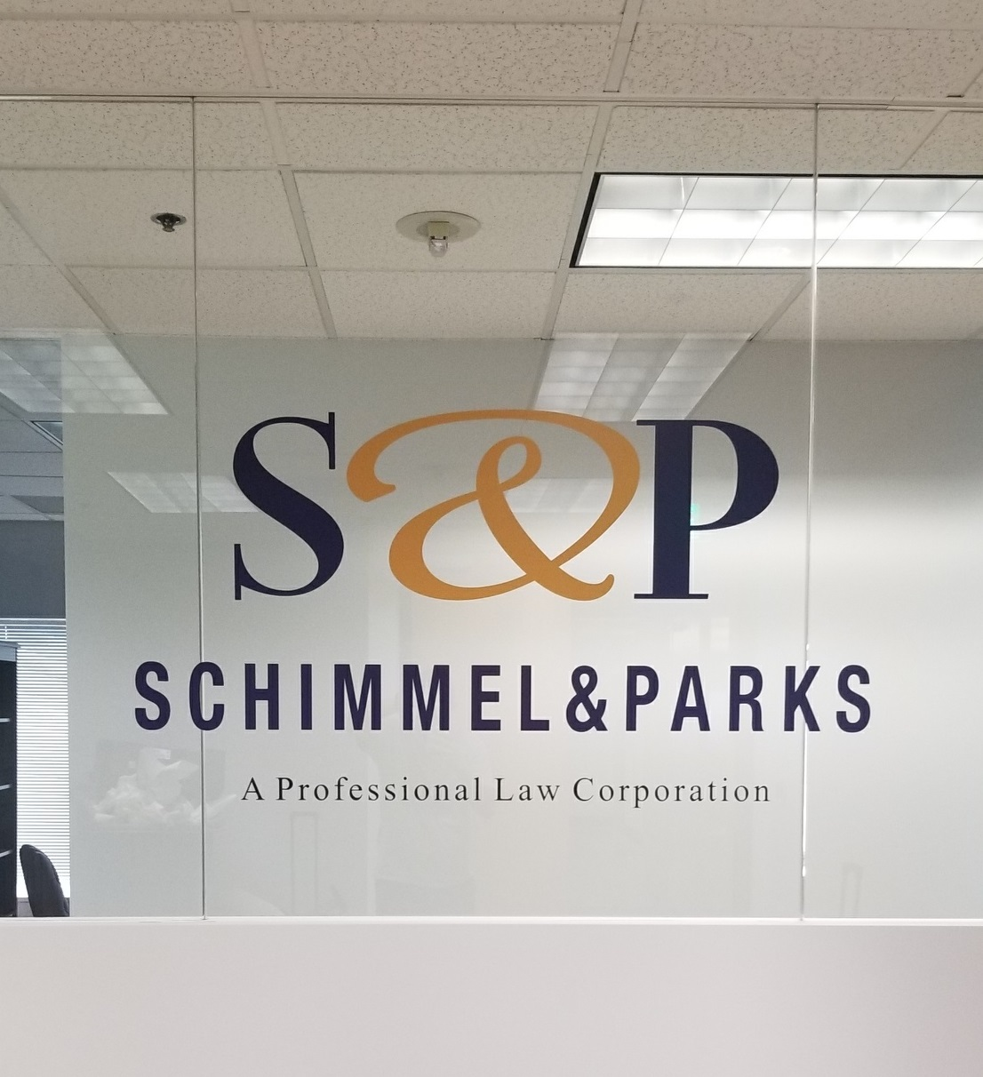 Office lobby window graphics for Schimmel and Parks. With this signage, the Sherman Oaks law firm's reception area looks absolutely fetching.