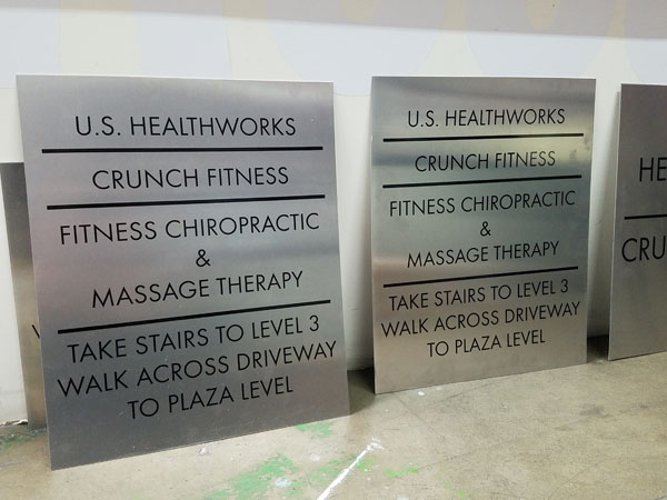 Parking Lot Wayfinding Sign for Crunch Fitness in Oceangate, California Sign Fabrication and Installation for Crunch Fitness Southern California Los Angeles California Gym Sign Package Los Angeles Sign Company Premium Sign Solutions Southern California Sign Makers