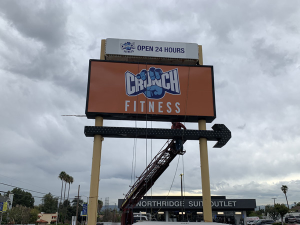 Completed Pylon Insert Installation for Crunch Fitness in Northridge, California Sign Fabrication Installation Los Angeles California Gym Sign Package Los Angeles Sign Company Premium Sign Solutions Southern California Sign Makers