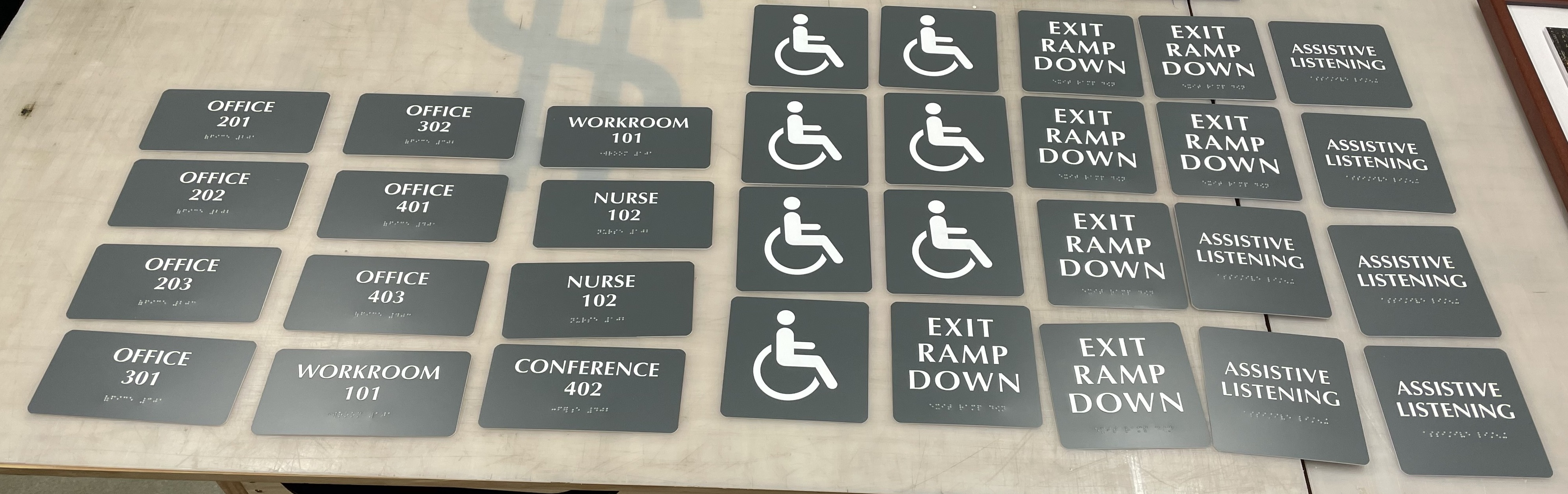 Braille signs are crucial for making areas more accessible. Like theseADA signs with tactile lettering and braille for Sinanian Development.