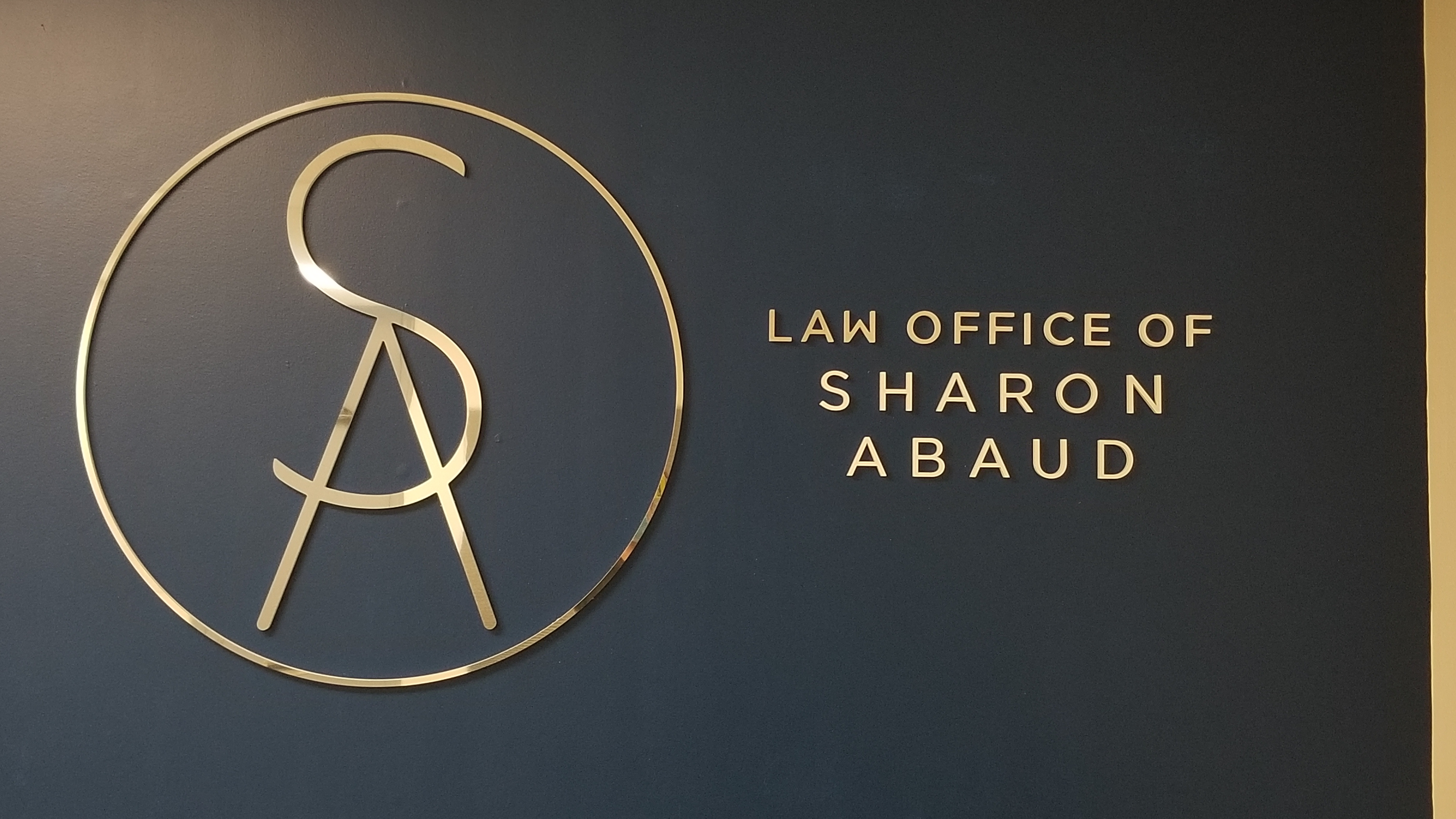 This is the laser-cut acrylic lobby sign we made for the Torrance law office of immigration lawyer Sharon Abaud.