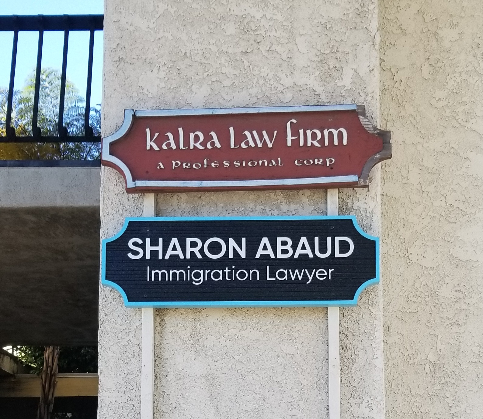 This custom wood sign is part of the business sign package for Sharon Abaud's law firm in Torrance.