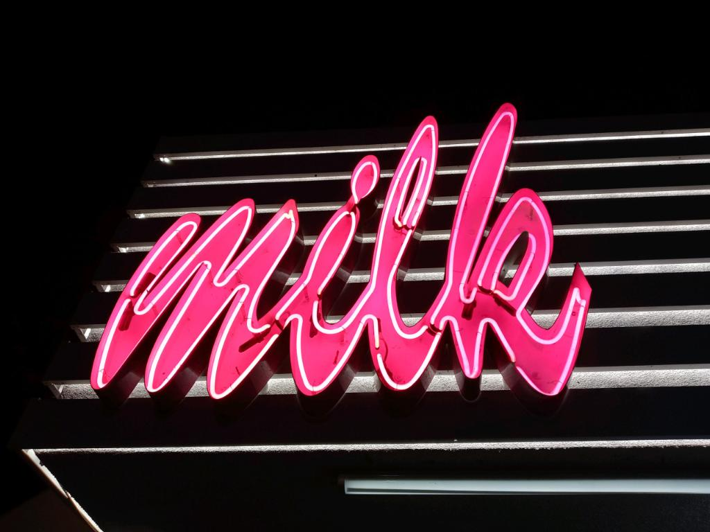 Milk Bar's neon sign had multiple letters no longer functioning. So we did neon sign repair, fixing the electrical and inserting new neon gas into its tubes.