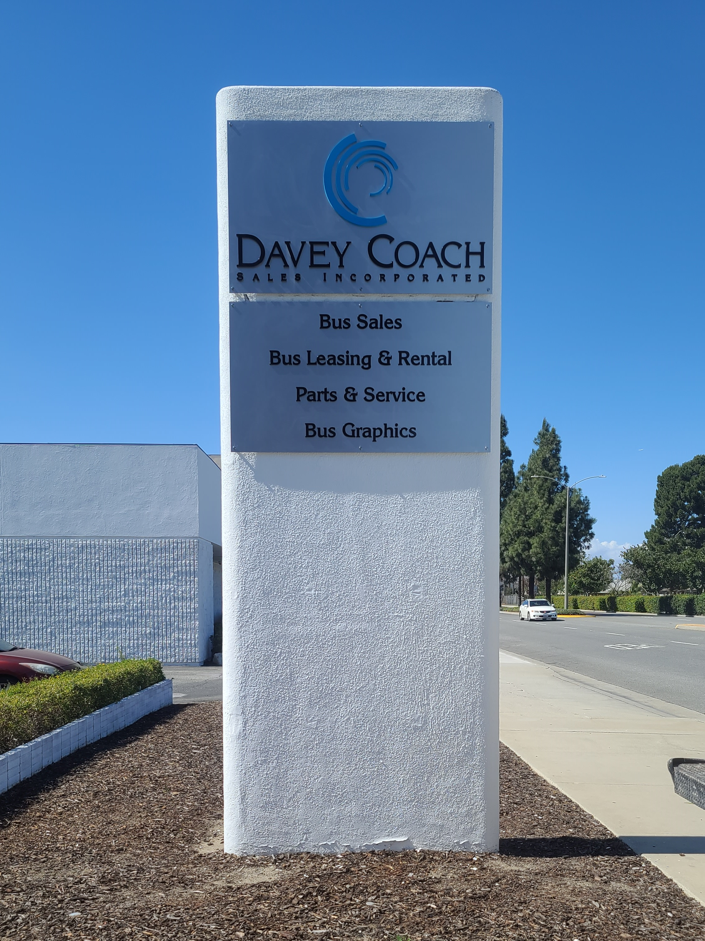 Dimensional letters business sign package for Davey Coach's Norwalk establishment.