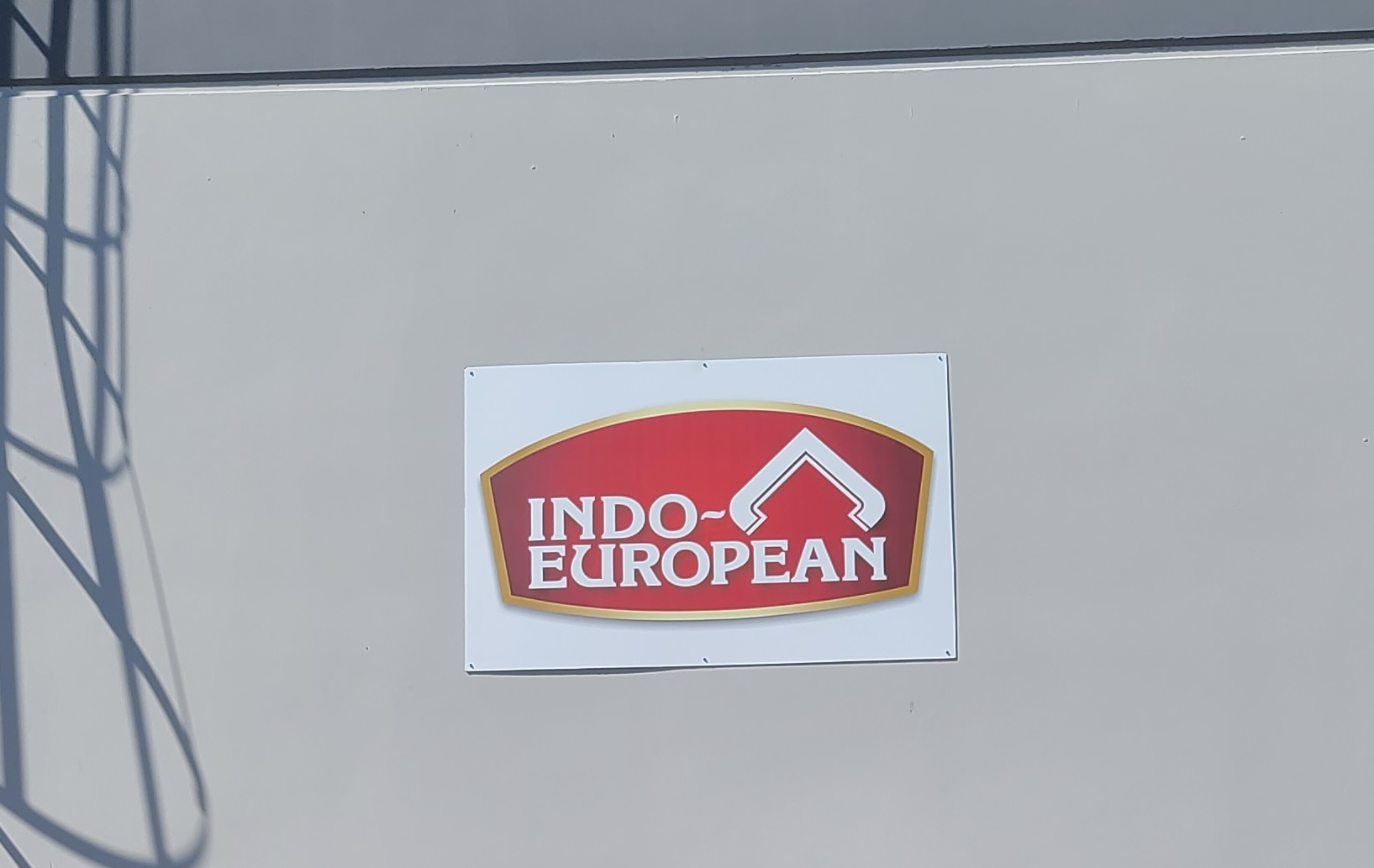 Our custom metal business sign package for Indo-European's Commerce facility loading bay.
