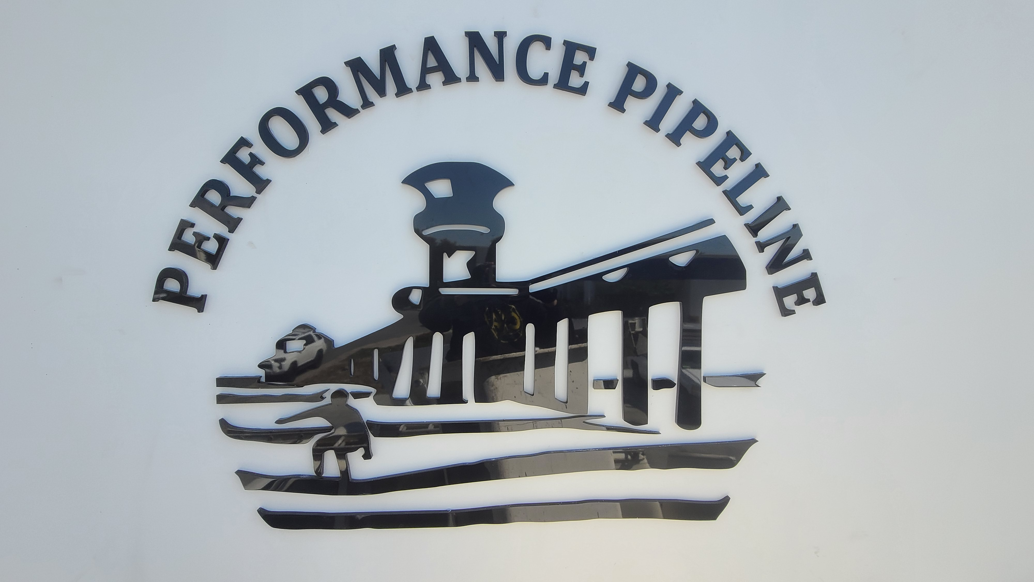 A closer look of the company logo and address numbers signs we made for Performance Pipeline in Huntington.