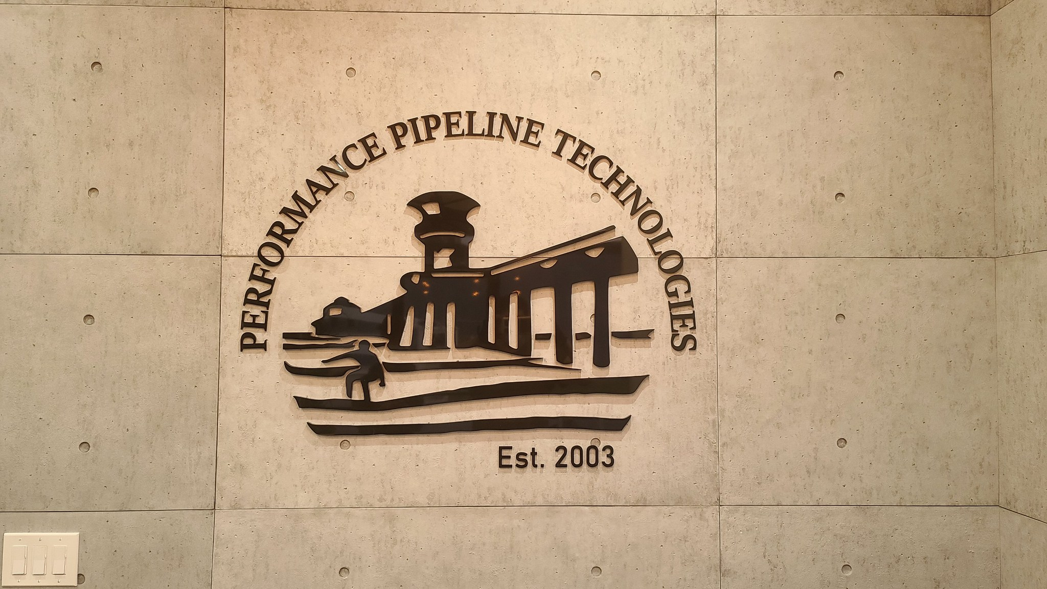 Now for the interior signs for Performance Pipeline: this office lobby sign enhances the workspace of their Huntington Beach establishment.