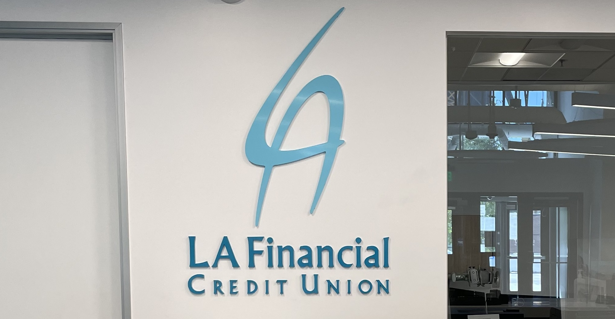 This is the lobby sign we made for LA Financial's office. In a bustling workplace like this, it helps to have a centerpiece to signify the company's brand.
