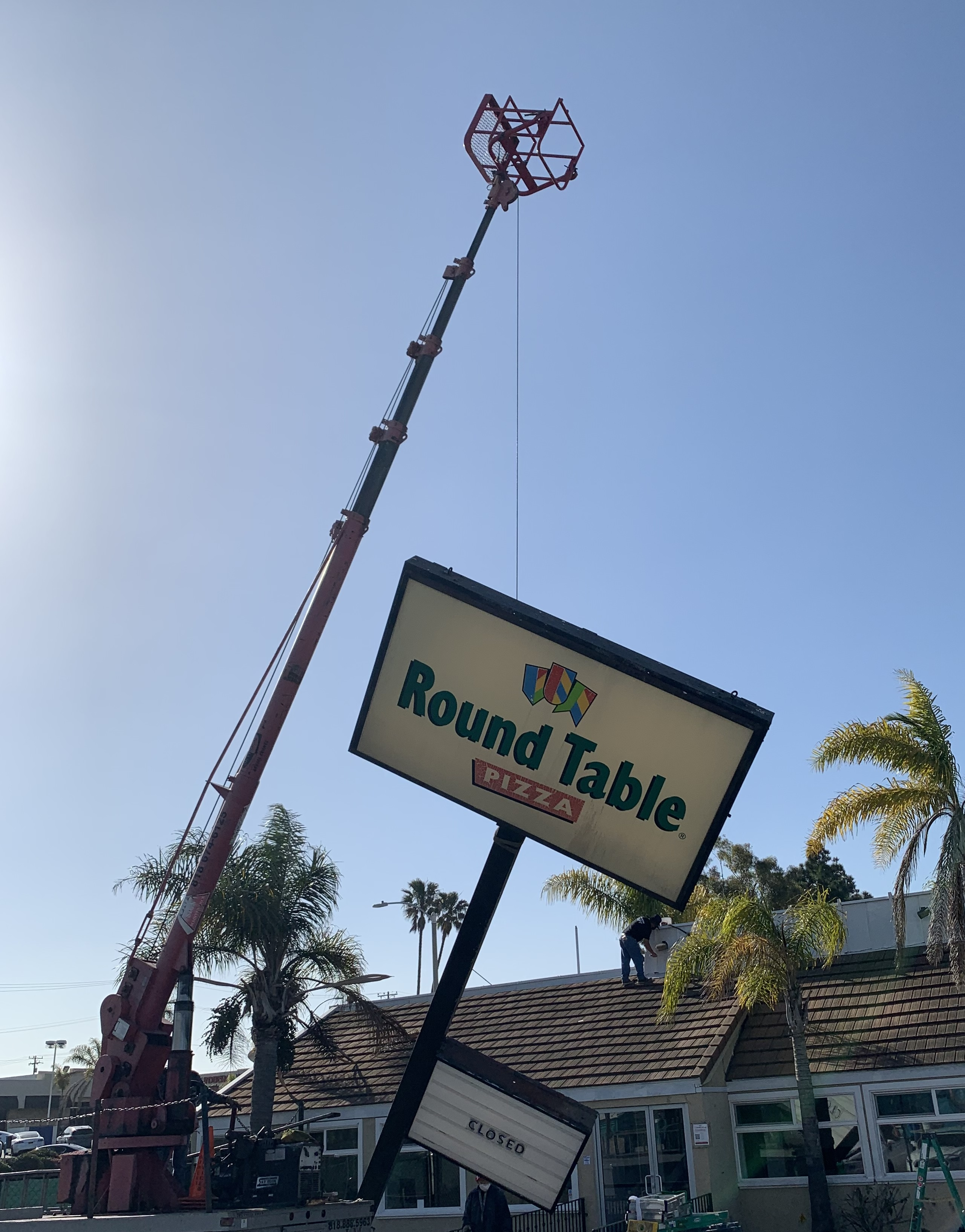We removed Round Table Pizza's giant pole sign for Sketchers' world headquarters. Who better to provide sign removal service than a sign company?