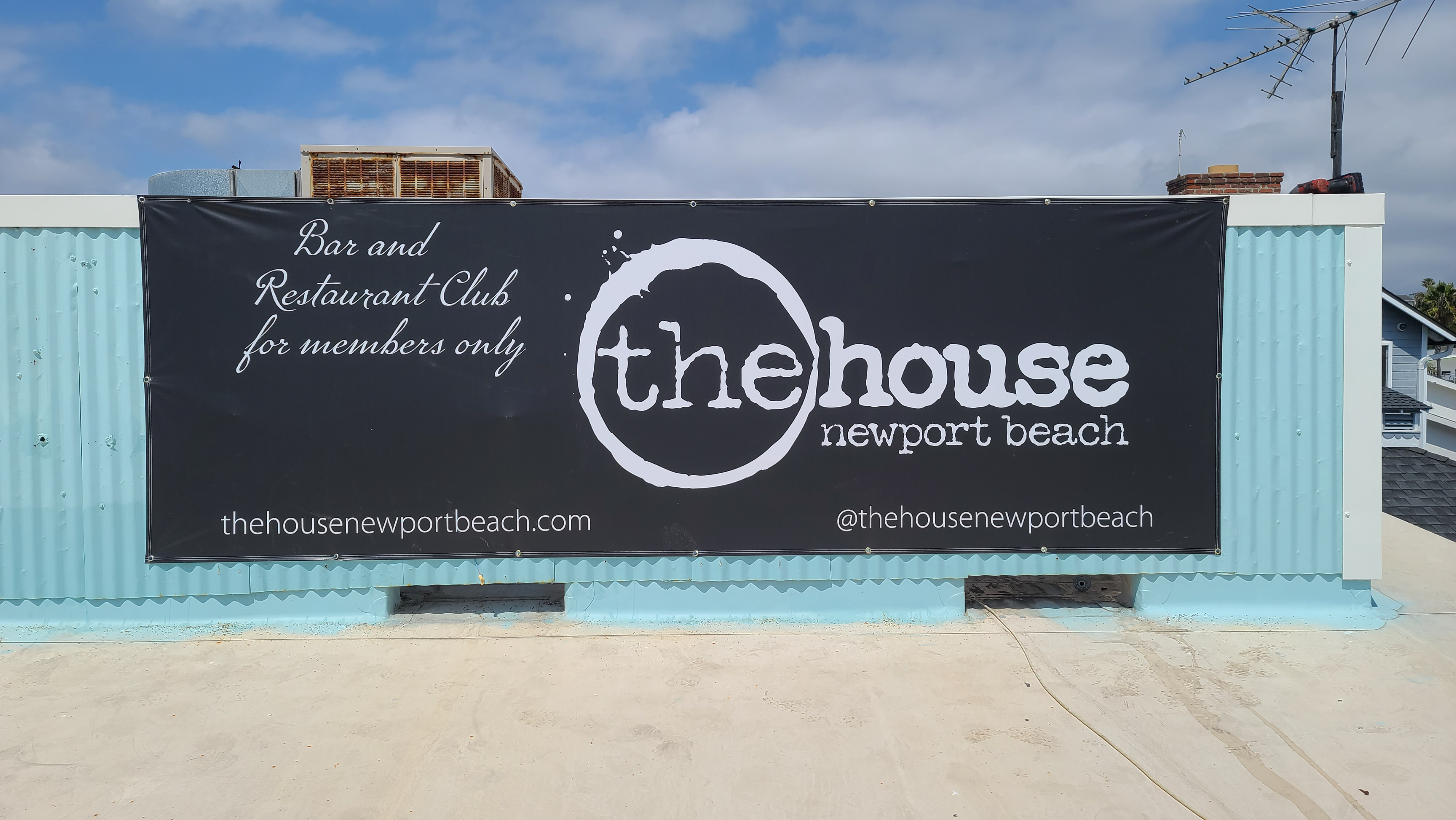 This is our exterior custom banner for The House Newport Beach, part of their restaurant banner sign package.