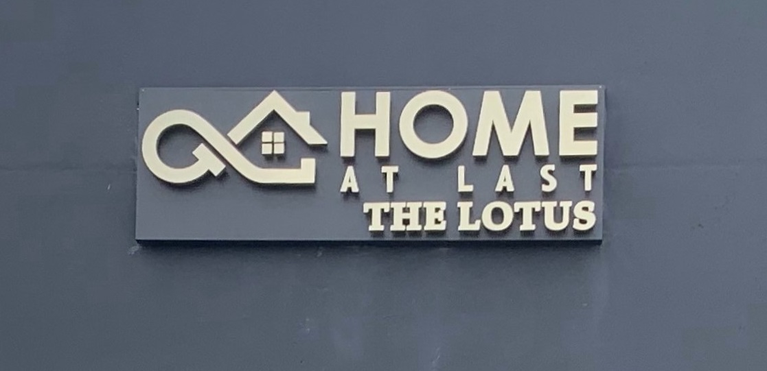 This is a day shot of our halo lit channel letters for Home At Last.