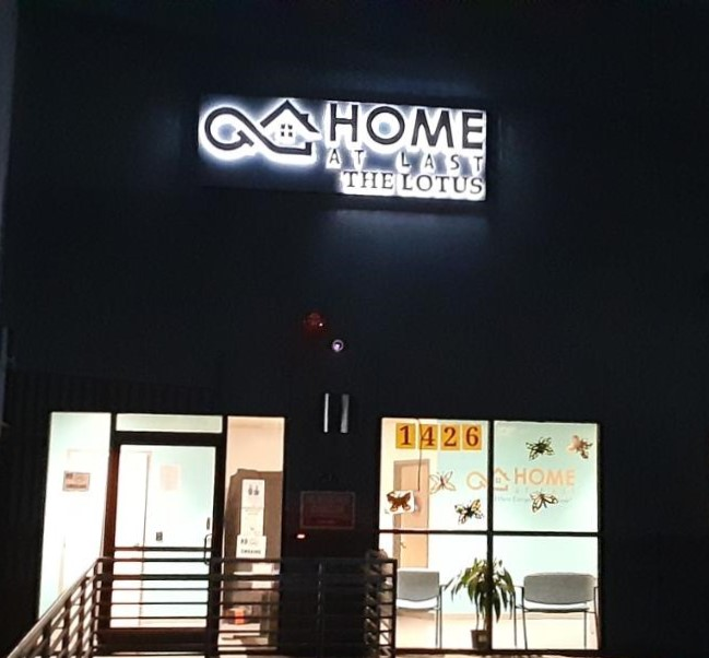 A night time picture of the halo-lit channel letters we made for Home At Last in Los Angeles.