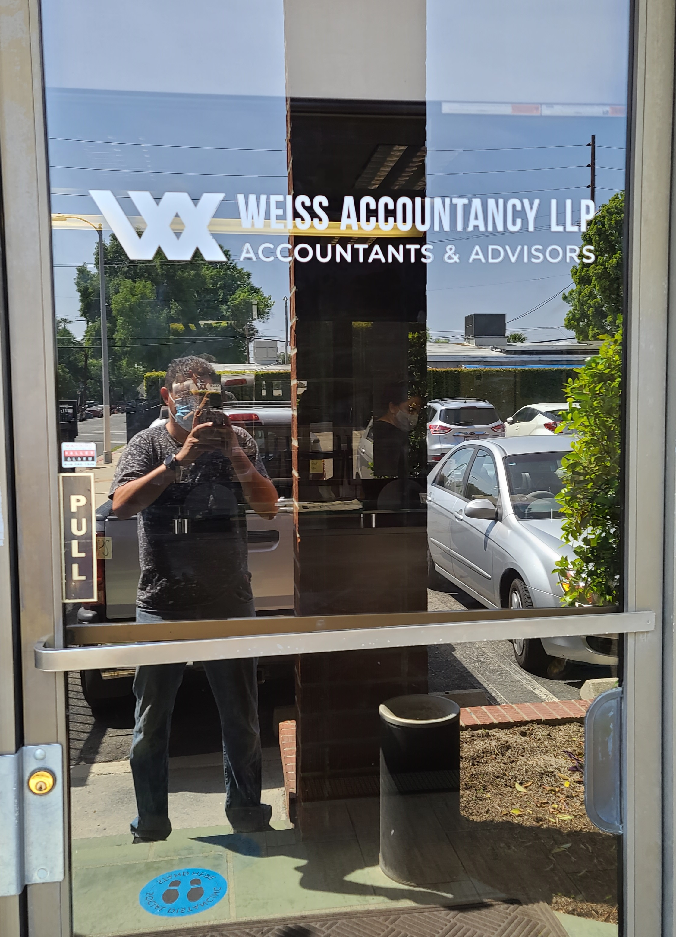 More signs made and installed for Weiss Accountancy. This time it is a window graphic business sign package that thoroughly decorates their Van Nuys office.