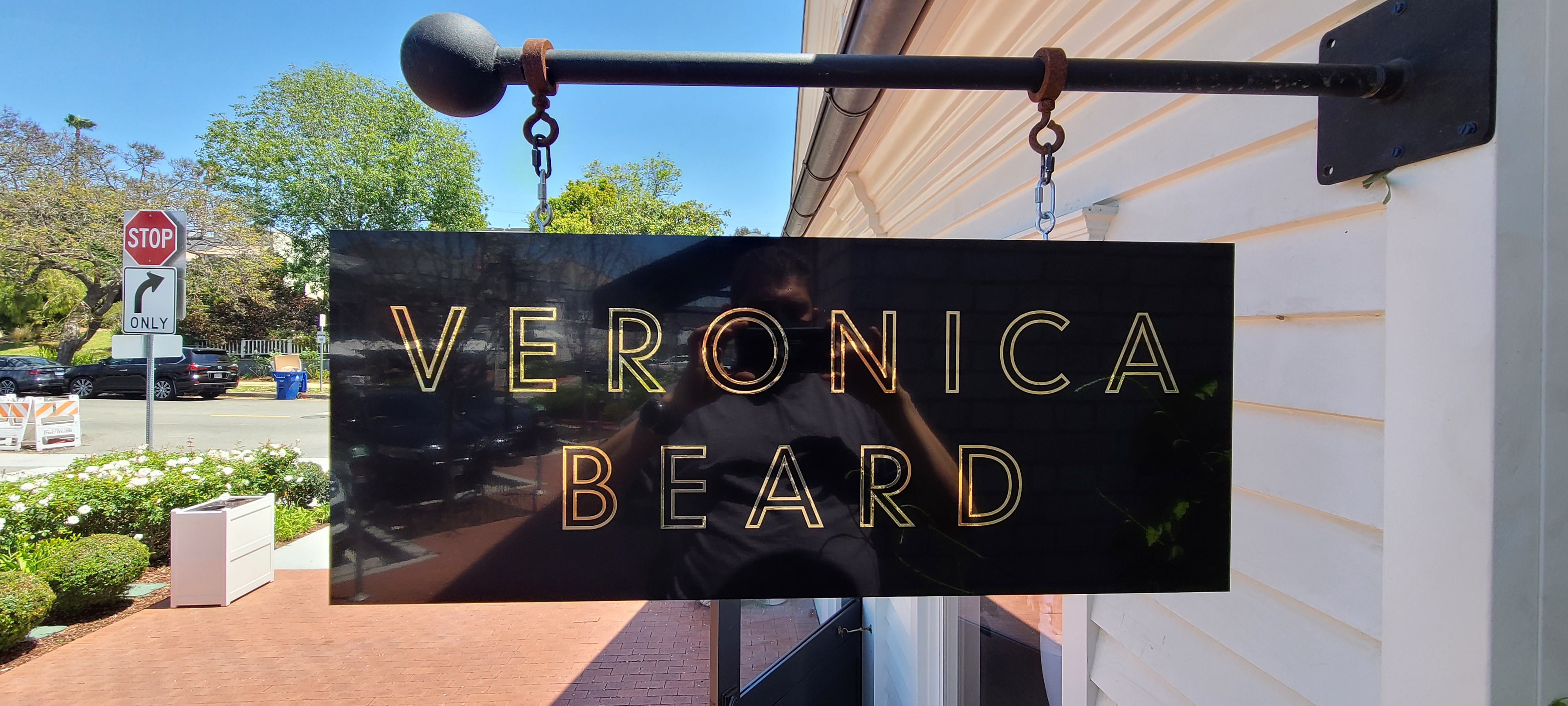 With more shoppers going out and about, captivating signage is a must. Like these blade signs for Veronica Beard in Pacific Palisades.