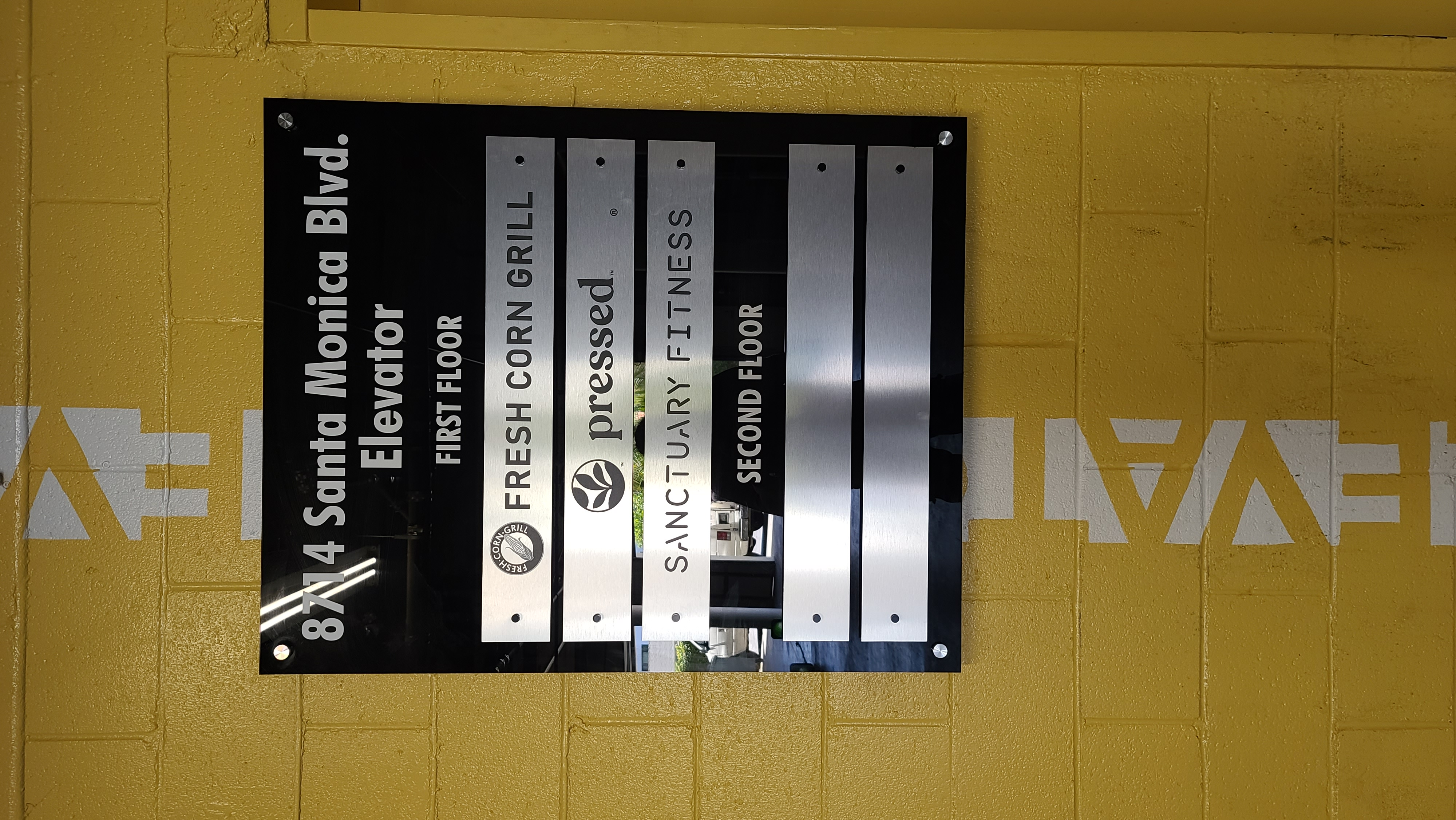 More from our sign package for Ronco Investments Inc. We fabricated and installed these basement directory signs in their Beverly Hills building.