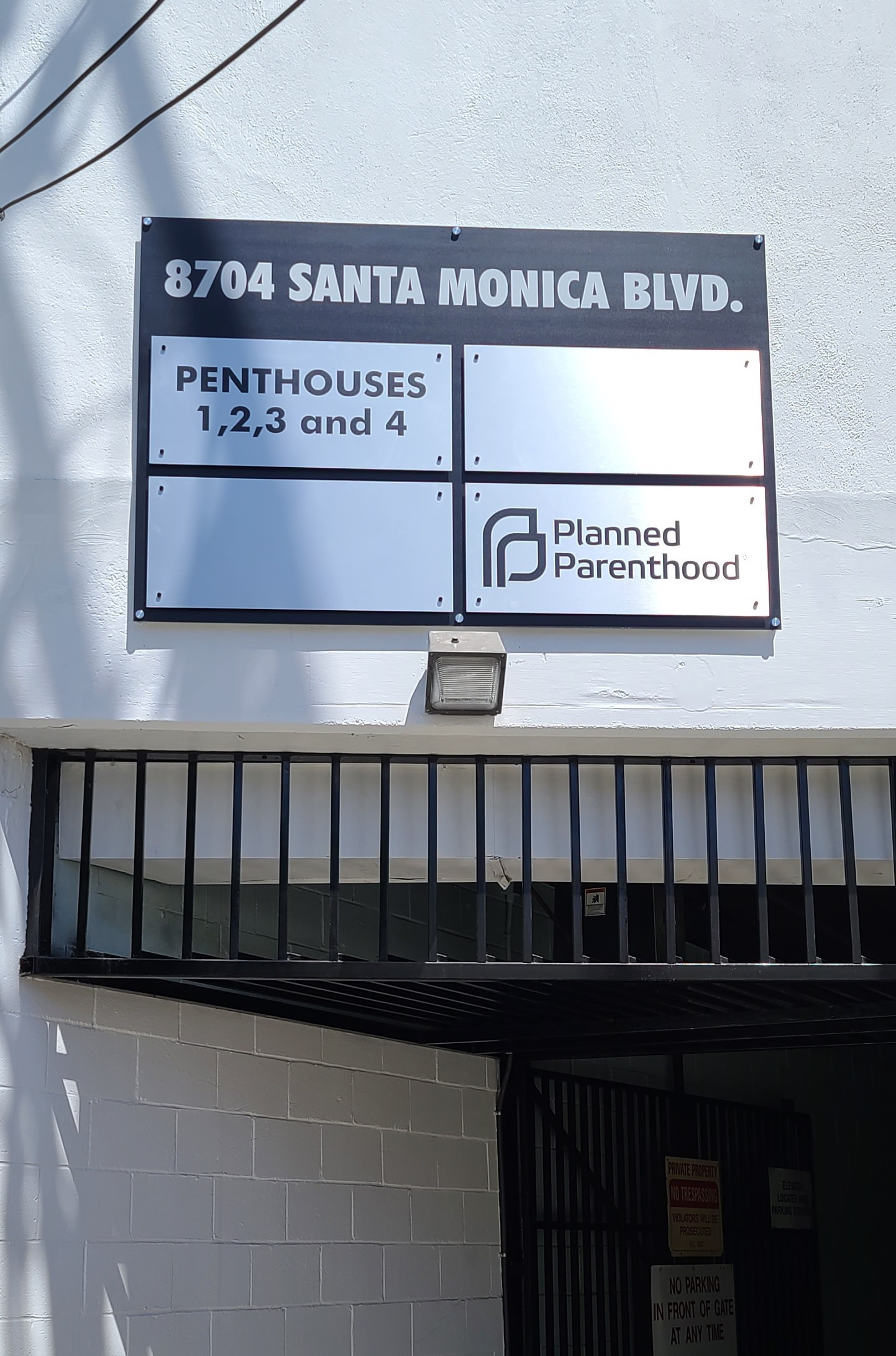 Parking lot sign packages, such as this one for Ronco Investments Inc. in Beverly Hills, can improve the customer experience.