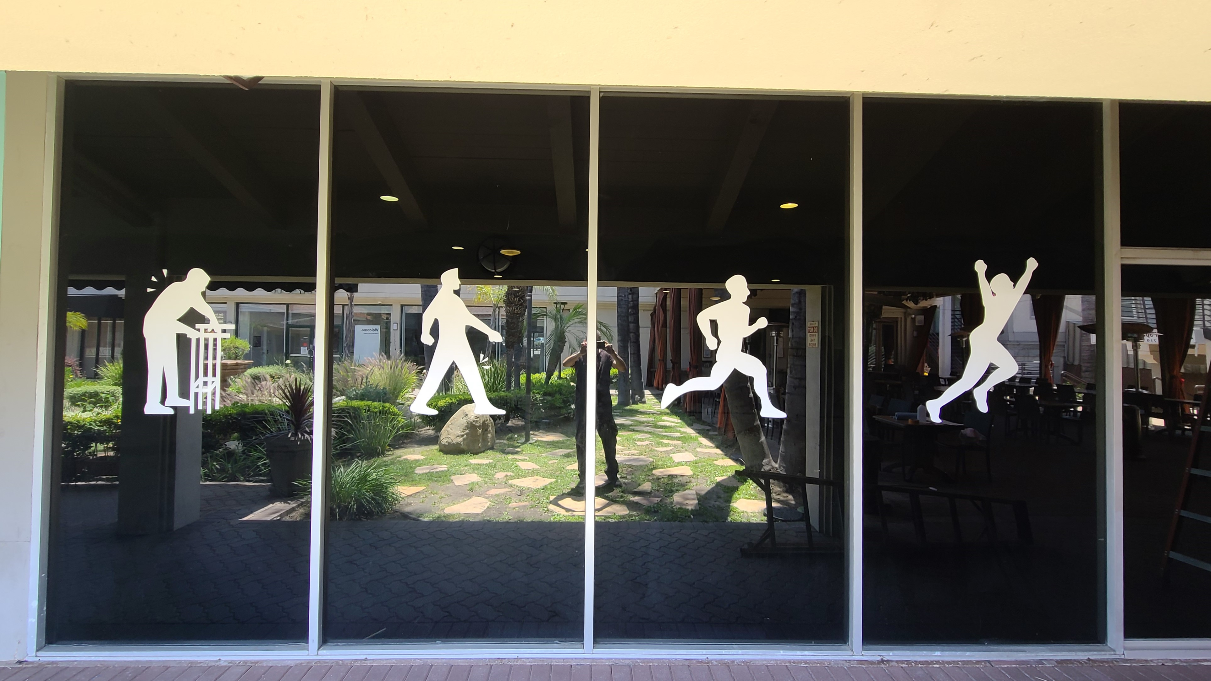 Building window graphics for Back 2 Health in Encino, as part of a comprehensive sign package for the physical therapy center.