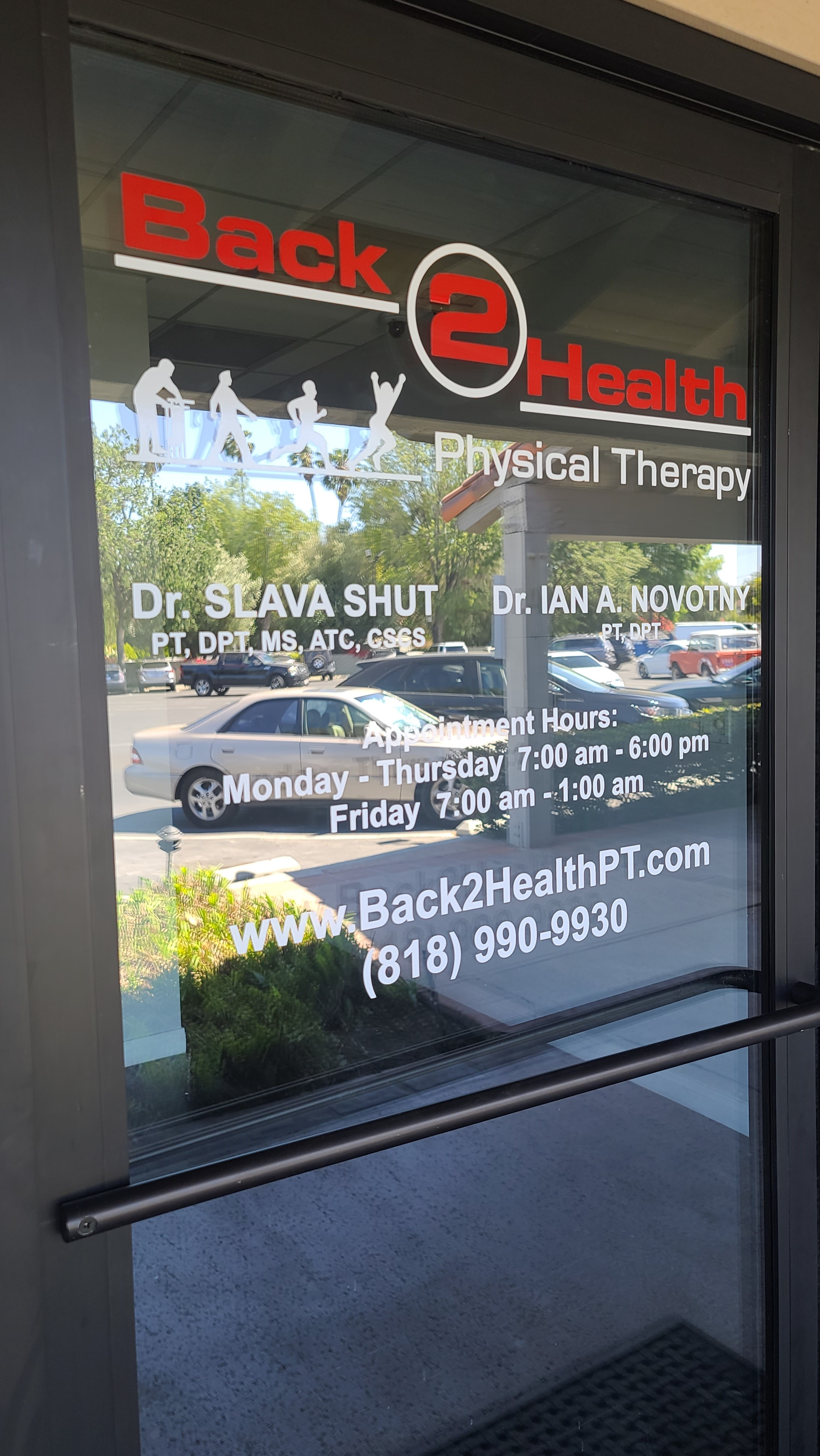 Doorway window graphics for Back 2 Health's sign package for their Encino physical therapy center.