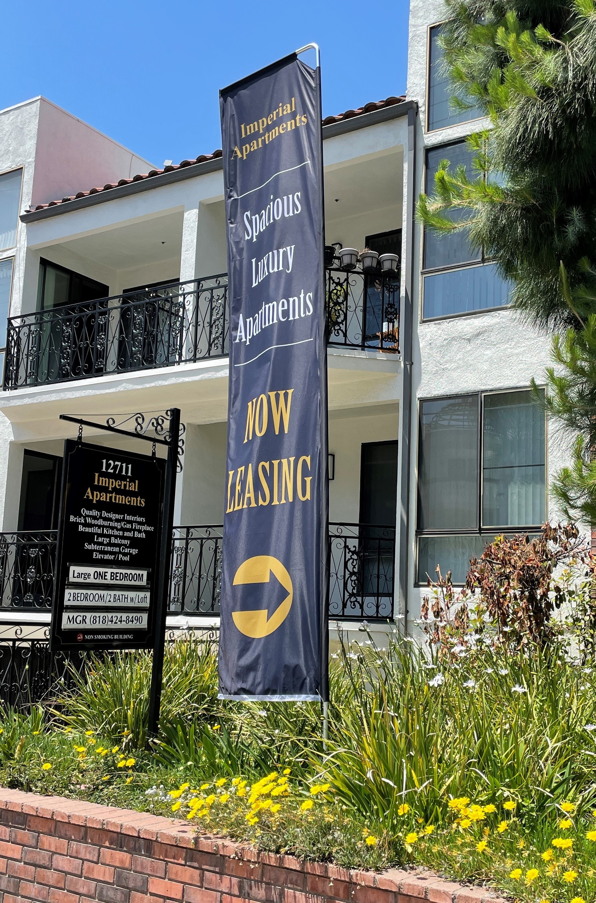 Real estate firms can reach customers better with advertisement banners detailing their properties. Like our signs for Imperial Apartments in Studio Cities.
