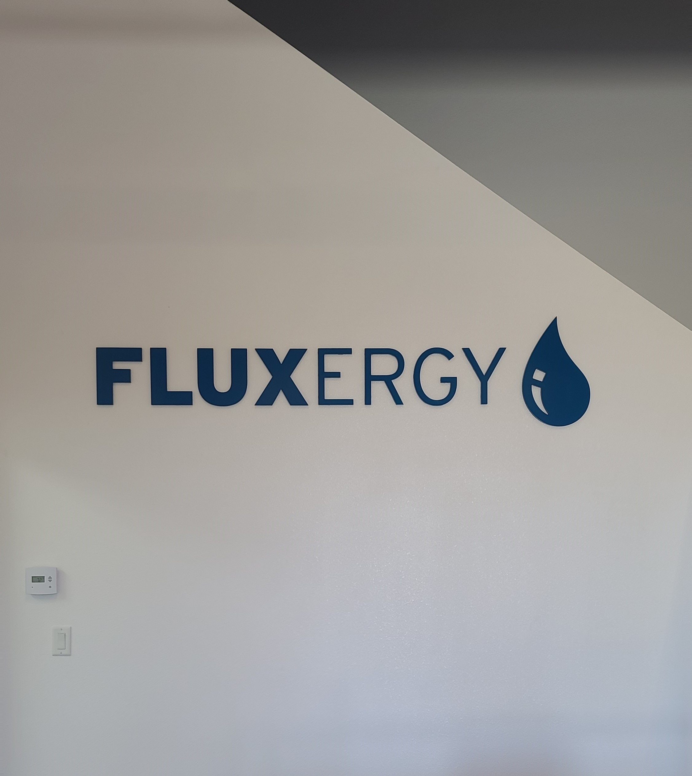 This is an indoor dimensional letter office sign for Fluxergy in Irvine, as part of the comprehensive sign package.