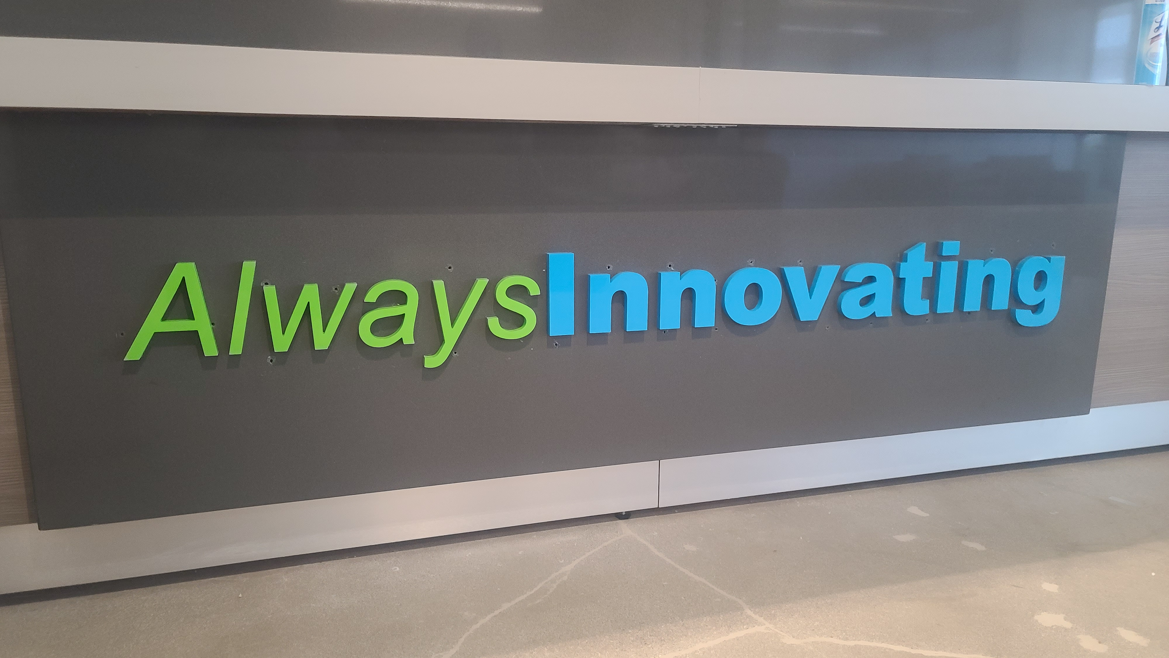 A lobby sign package can also display the company's tagline. Like this acrylic letters office sign for Transplant Connect's Los Angeles office.