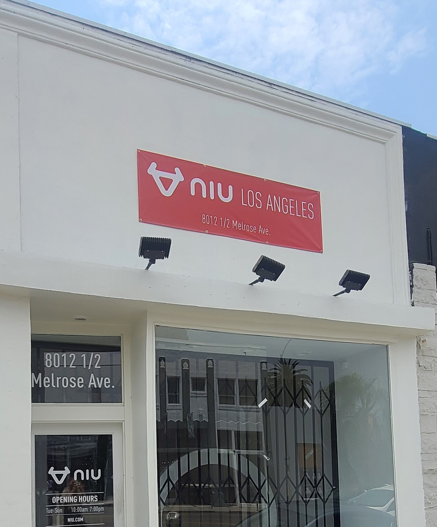Part of a sign package, this storefront banner gives NIU's Los Angeles branch more visibility before more permanent signage is installed.