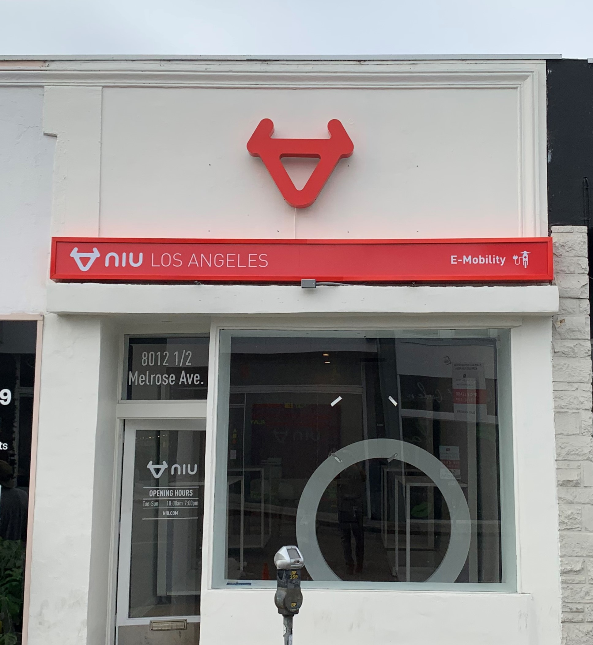 Part of the business sign package for NIU Los Angeles' West Hollywood branch. Their storefront sign is composed of a backlit logo and front lit light box