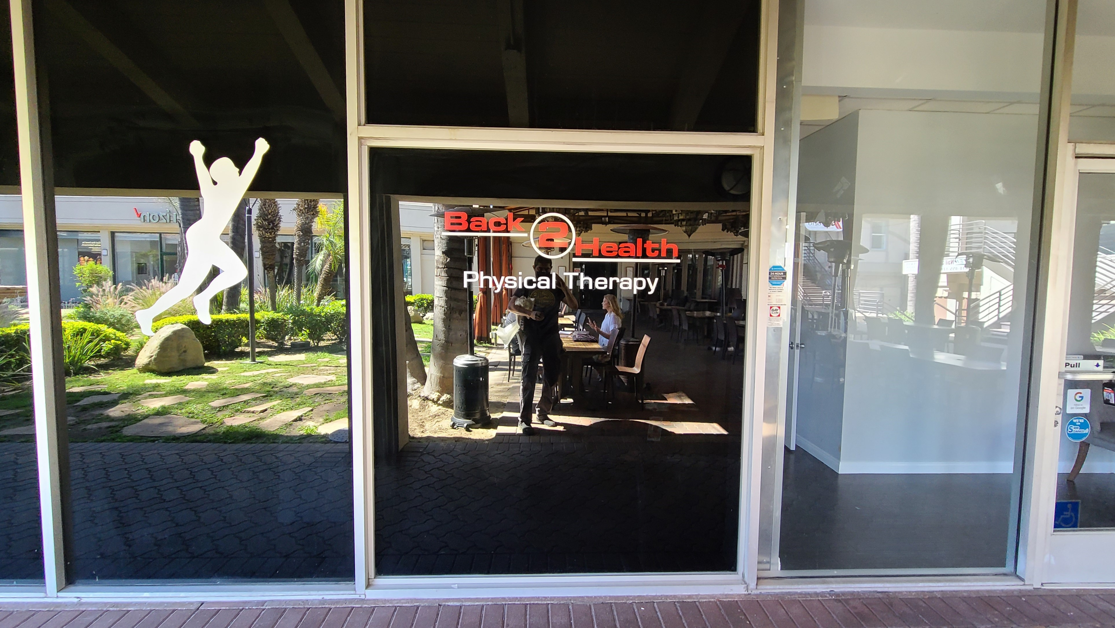 Part of the sign package we did for Back 2 Health, these window graphics decorate their door, greeting patients as they enter their Encino facility.