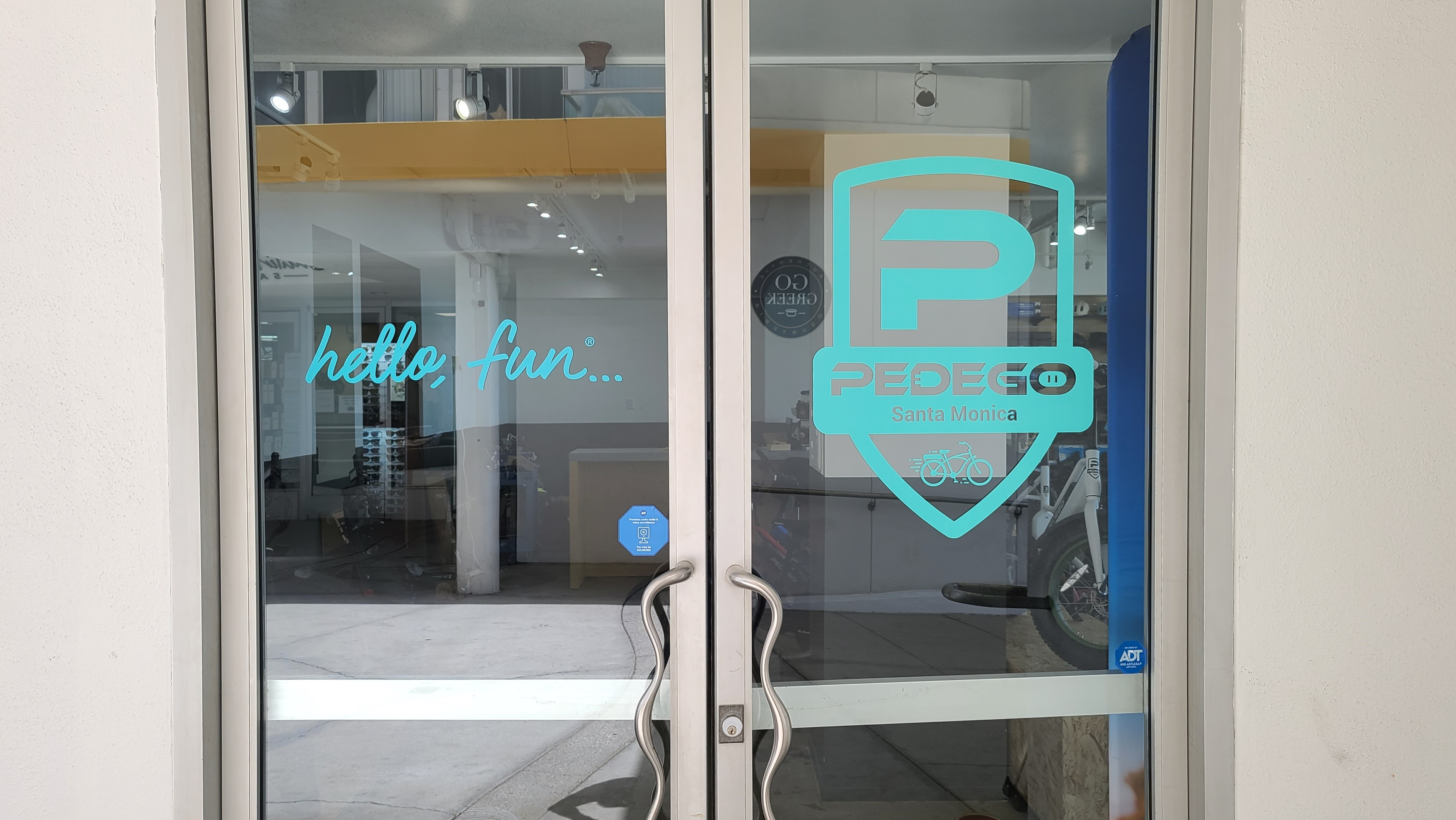 These door signs are part of our window graphics sign package for Pedego's Santa Monica branch and compliment the storefront signs for the electric bike seller.