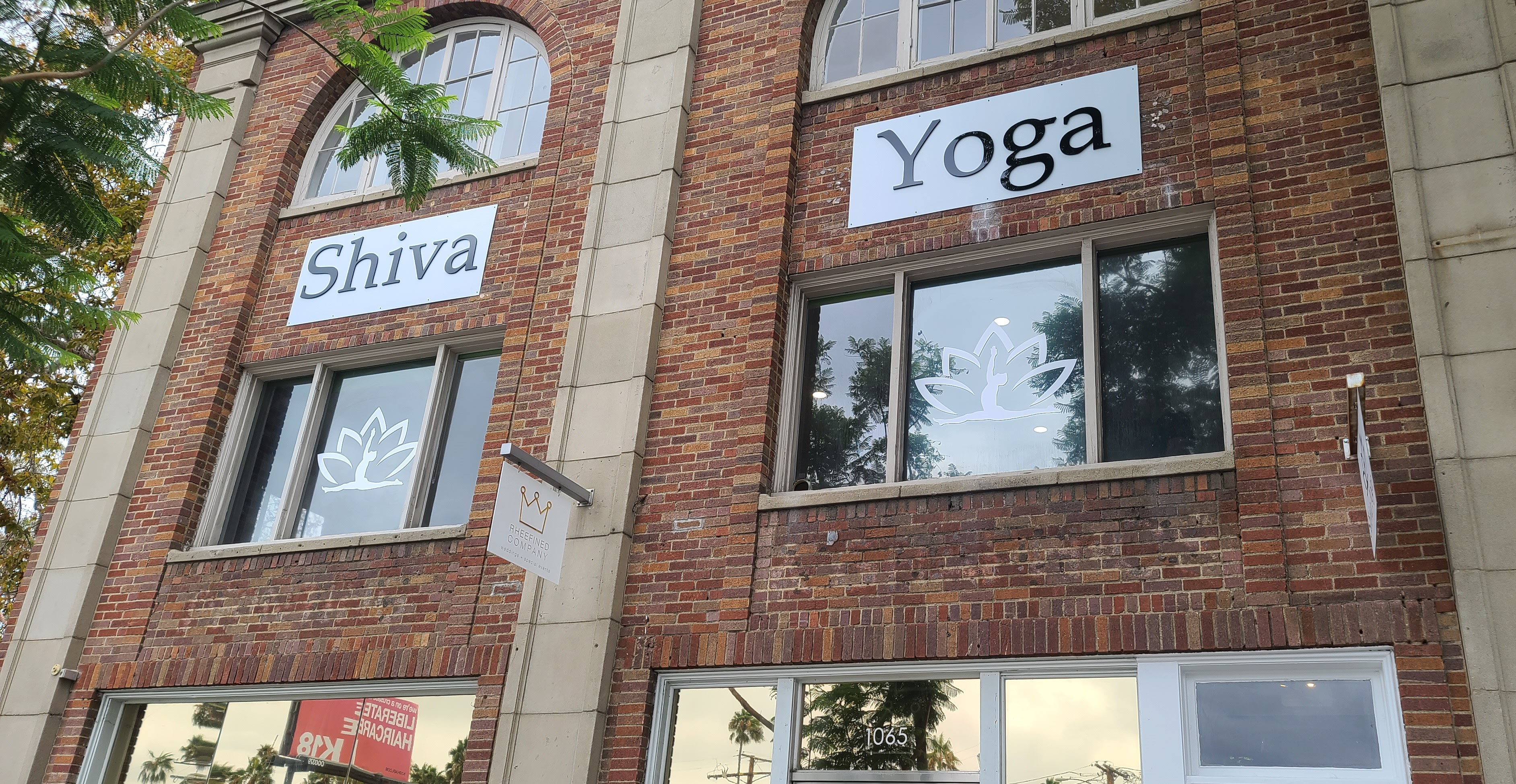 This is the studio sign for Shiva Yoga's West Hollywood establishment, composed of acrylic letters on a metal panel over their entrance.