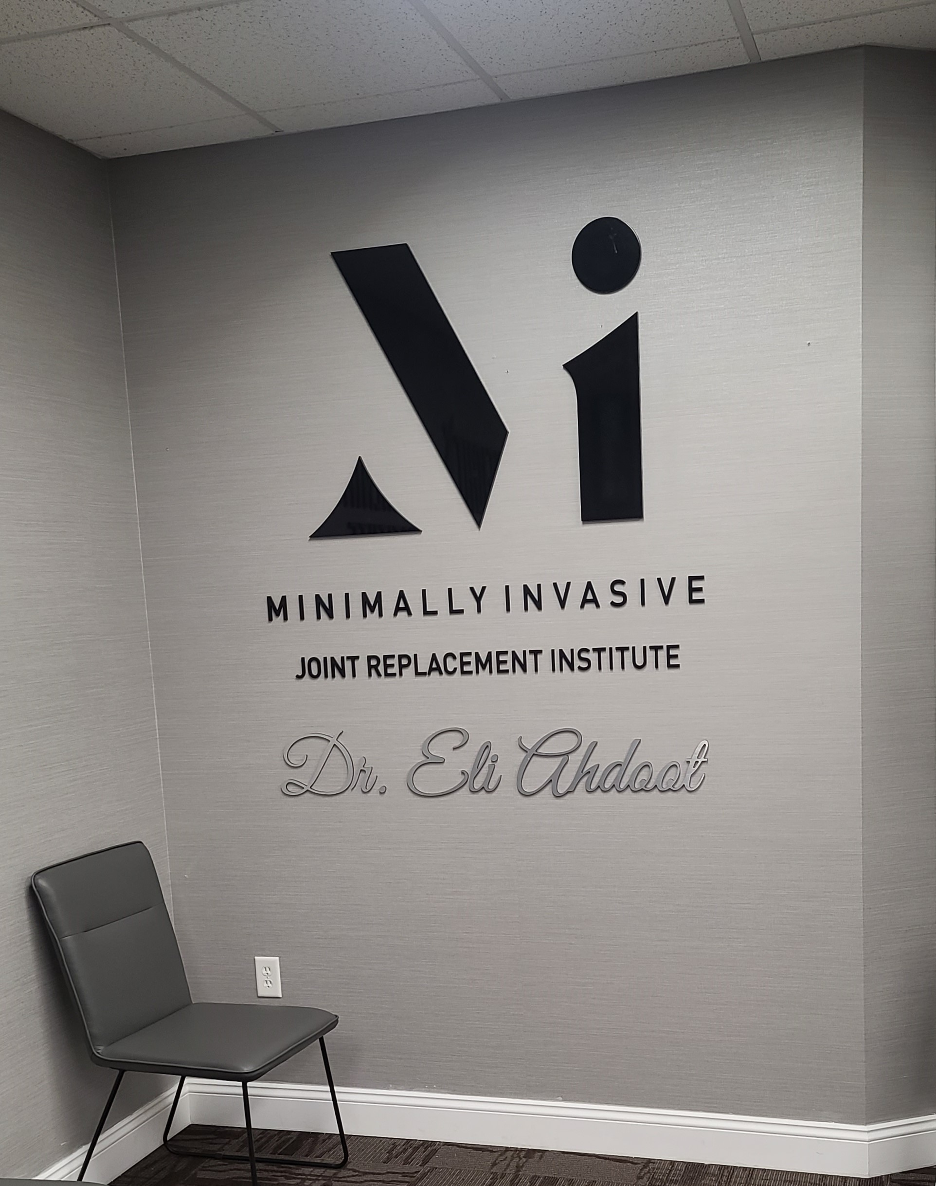 This clinic lobby sign we fabricated and installed for Minimally Invasive Joint Replacement Institute's Burbank practice enhances the office.