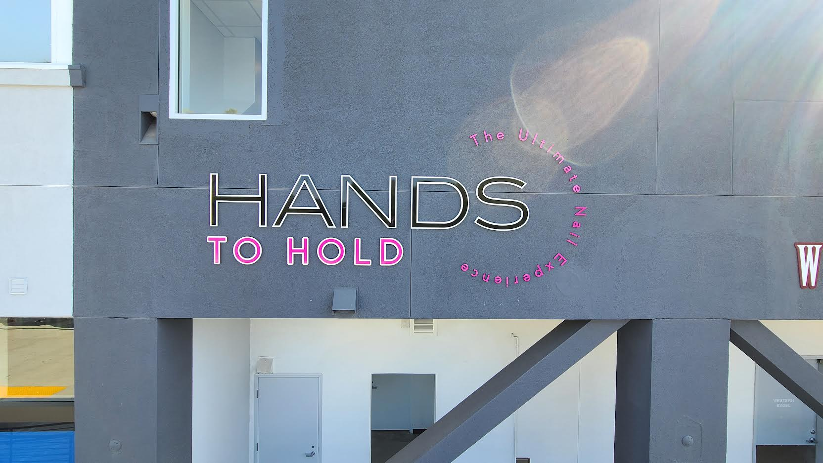 This is the salon sign for Hands to Hold's establishment in Encino Courtyard, it shows potential customers the caliber of the brand's styling services.