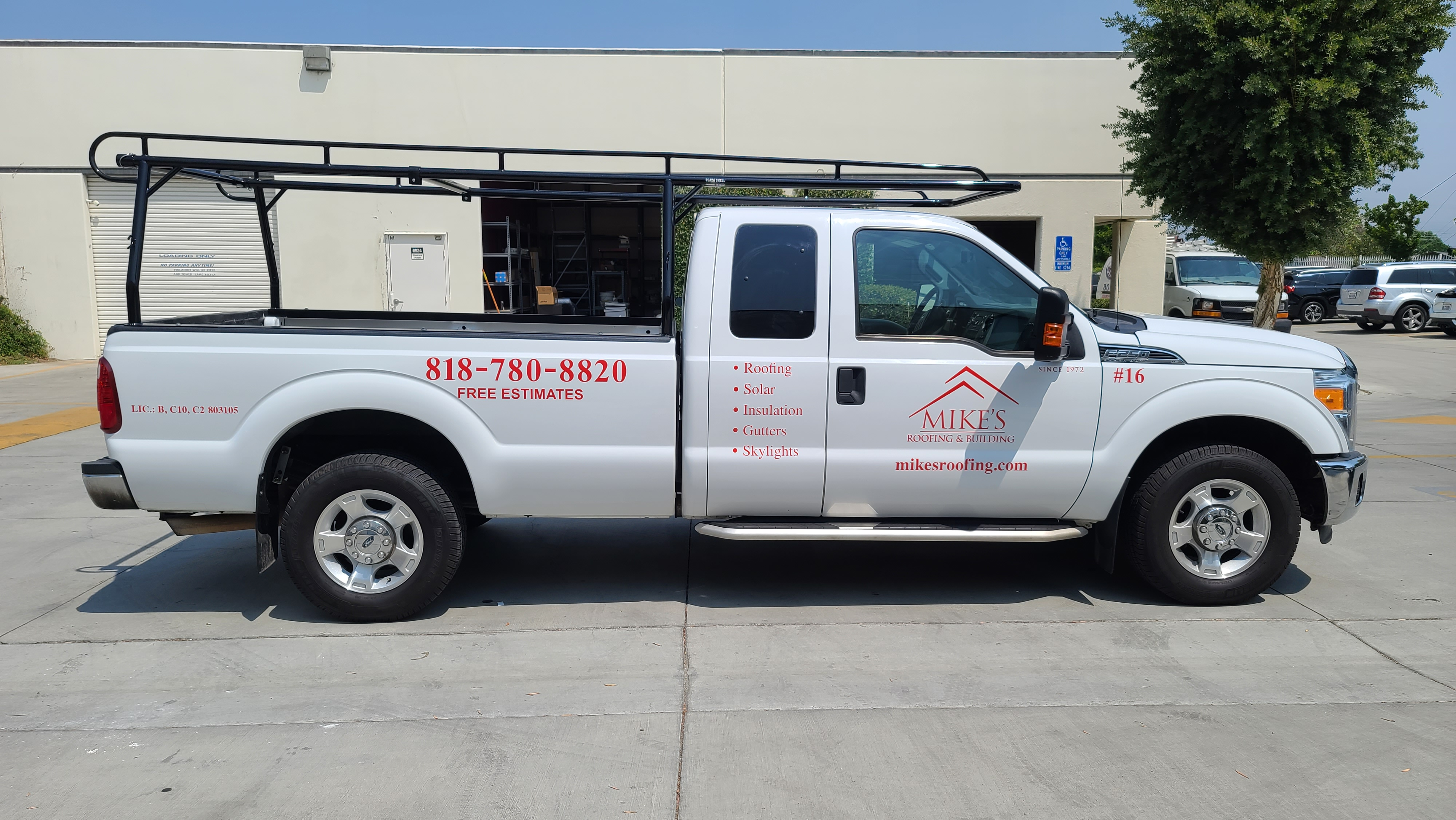 Rebranding also applies to vehicle wraps and graphics, like these new car decals for Mike Roofing's service truck featuring their logo and contact details.