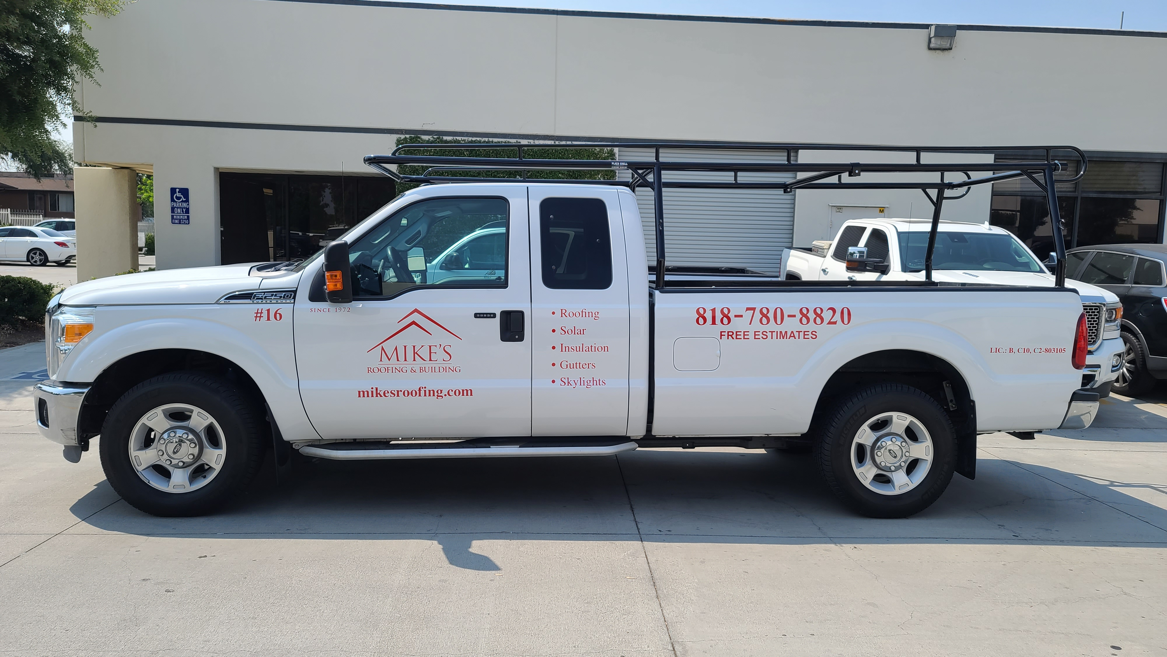 Rebranding also applies to vehicle wraps and graphics, like these new car decals for Mike Roofing's service truck that feature their company logo and contact details.