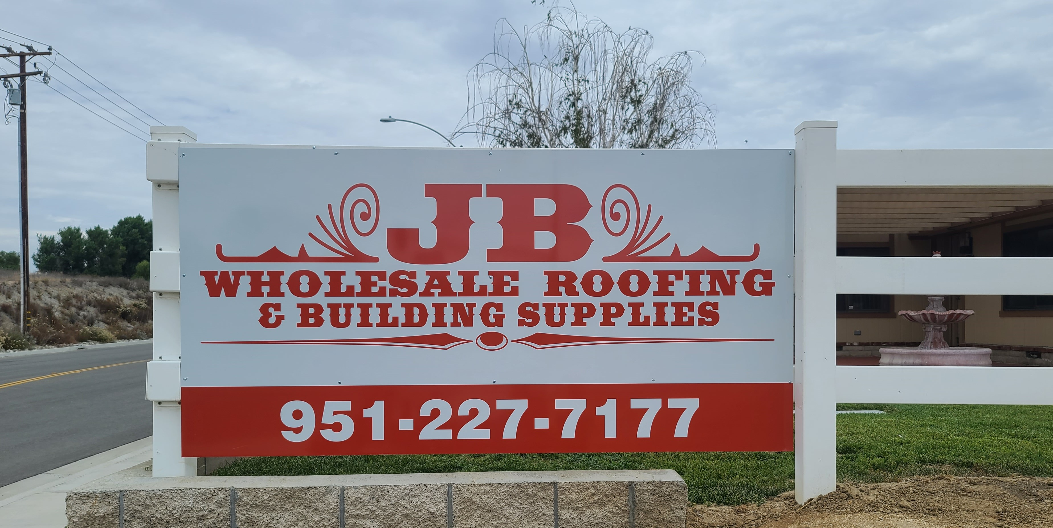 With this metal panel fence sign, JB Wholesale Roofing and Building Supplies' Murietta location will give their brand better visibility.
